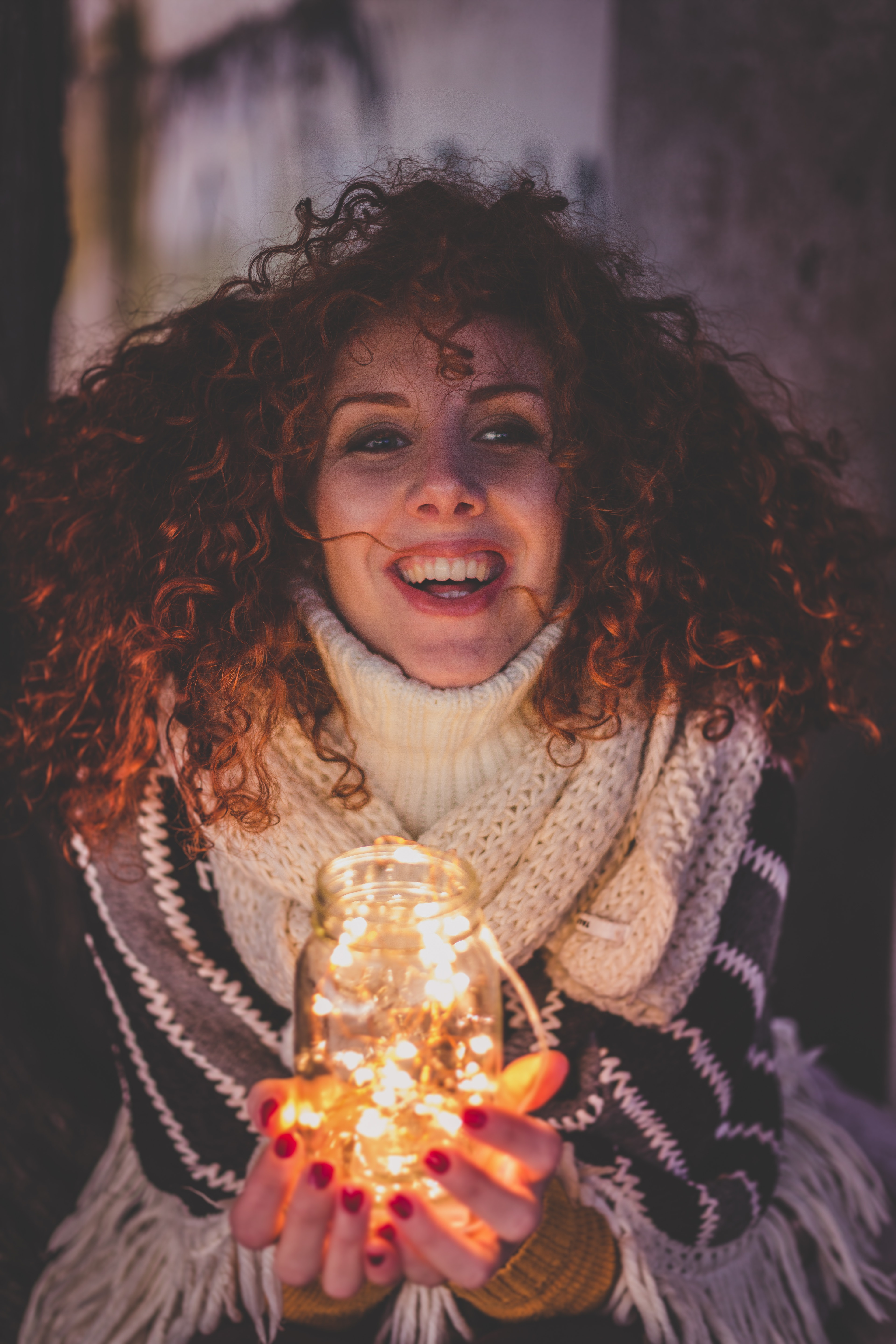 Woman holding a jar with string lights photo
