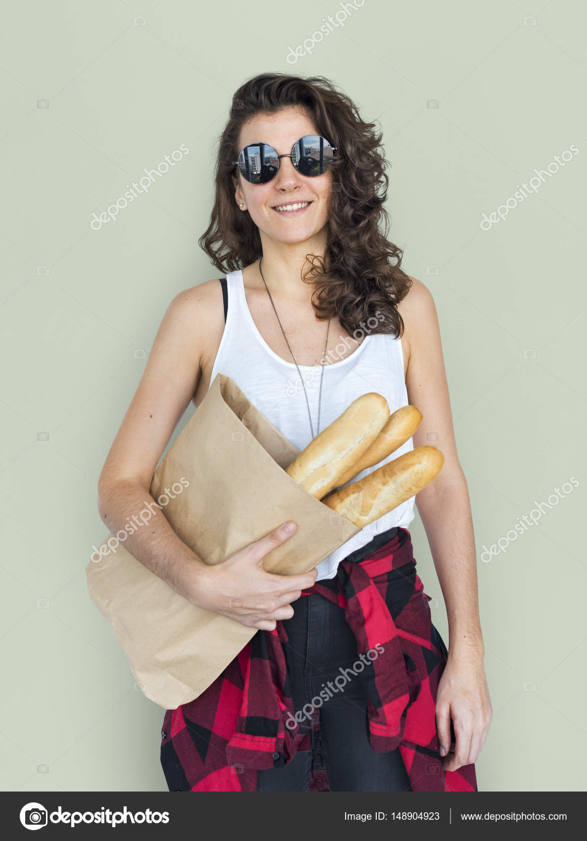 Woman holding bag with bread — Stock Photo © Rawpixel #148904923