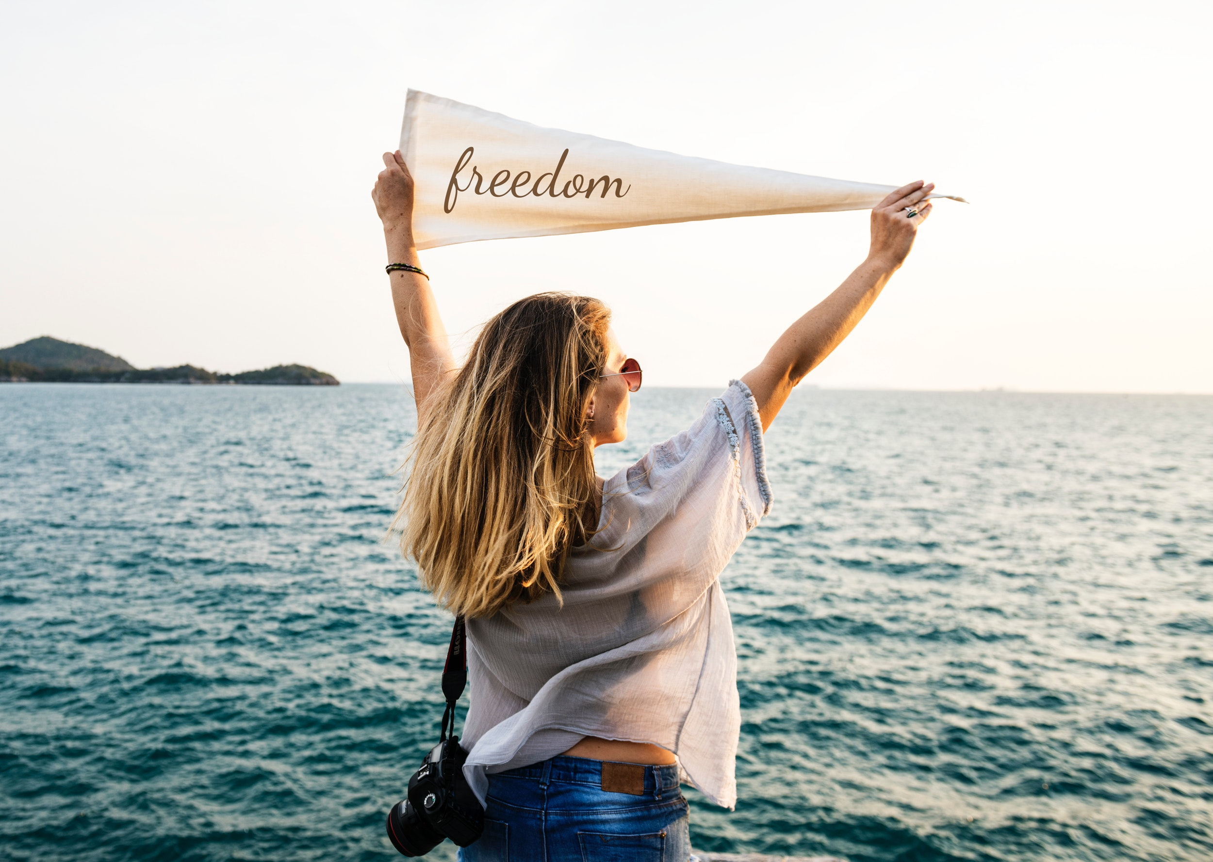 Woman holding beige freedom printed banner photo
