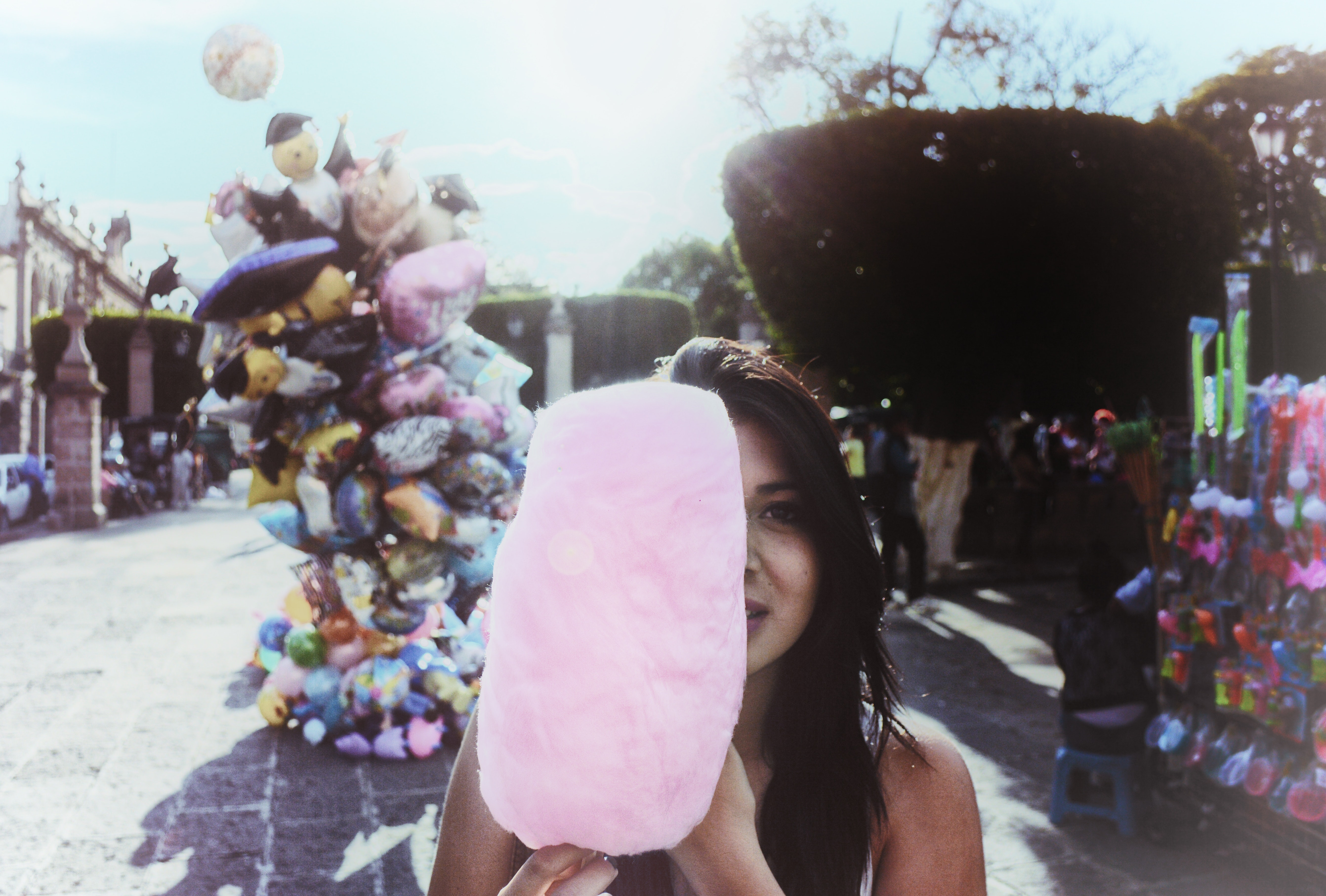 Woman Holding Cotton Candy With Balloons in Background, Happiness, Young, Woman, Shadow, HQ Photo