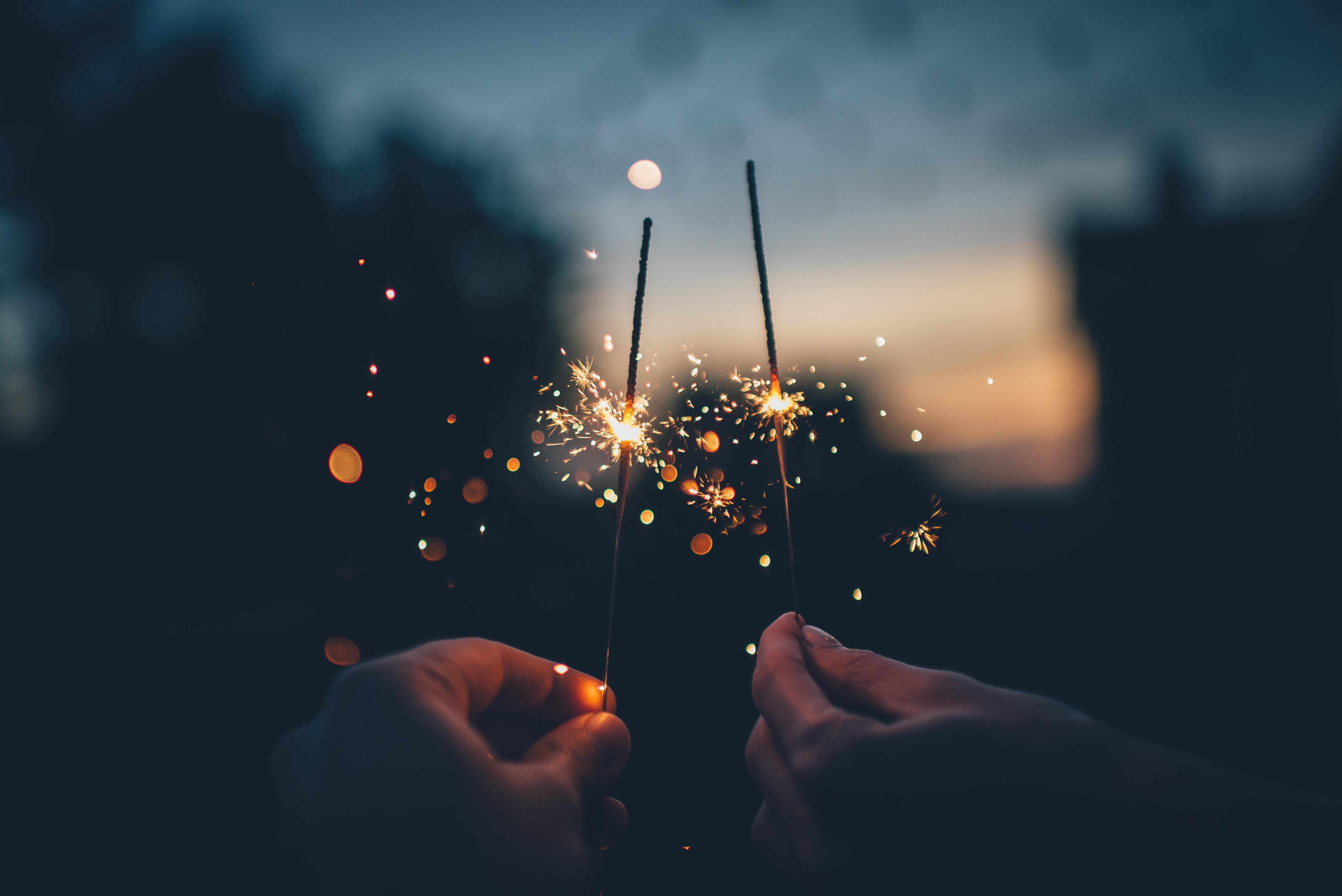 Person holding sparkler firework at nightime HD wallpaper ...
