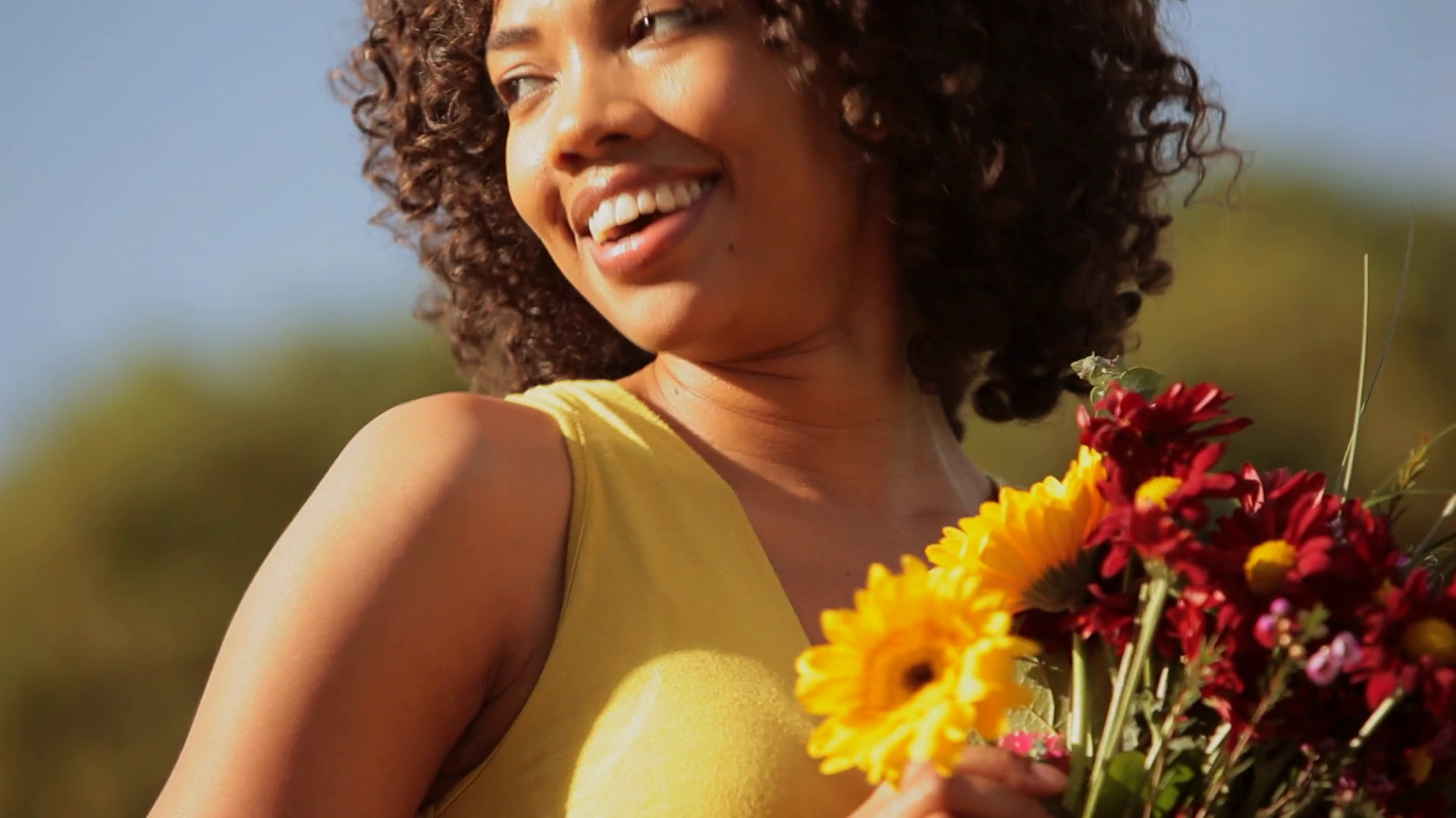 Young woman holding flowers and laughing Stock Video Footage ...