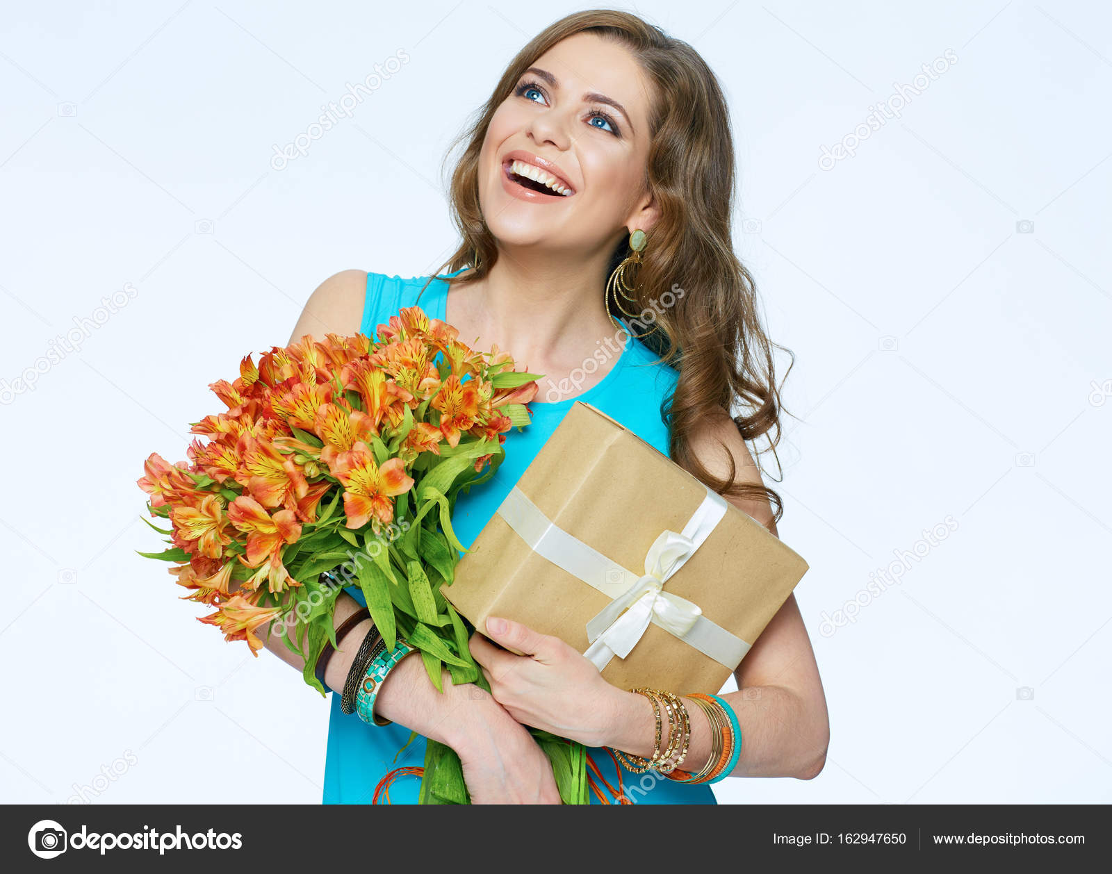 Toothy smiling happy woman holding flower with gift box. — Stock ...
