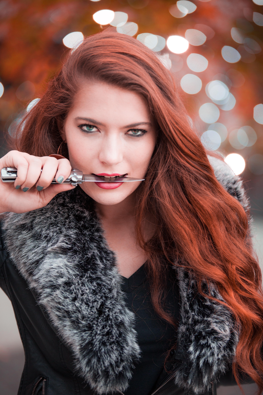 Woman holding gray handled knife photo