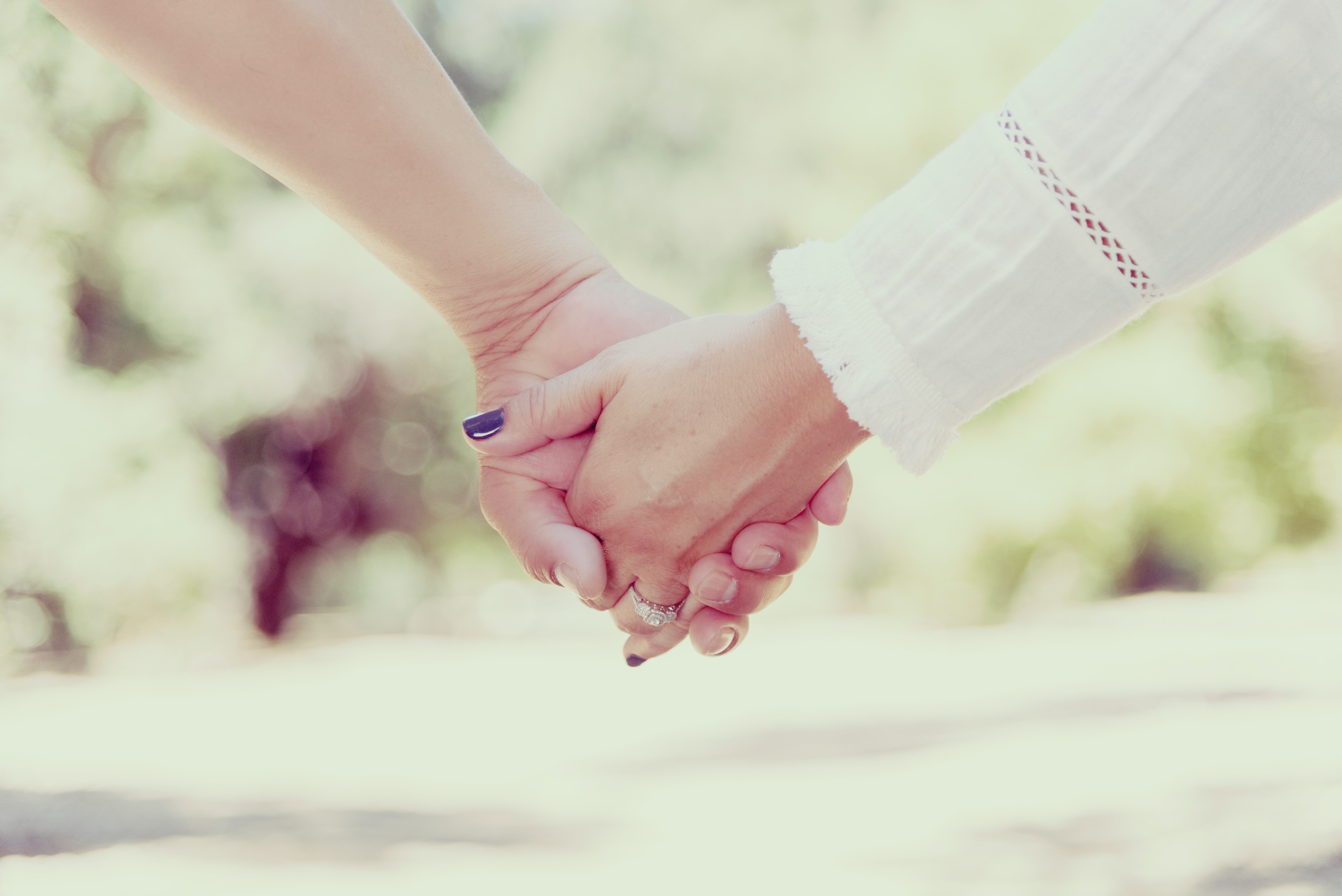 Woman holding hands photo