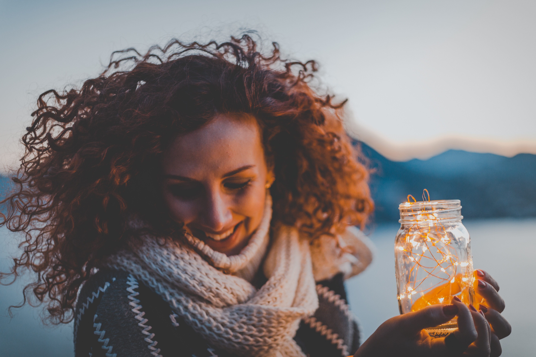 Woman holding lighted jar photo