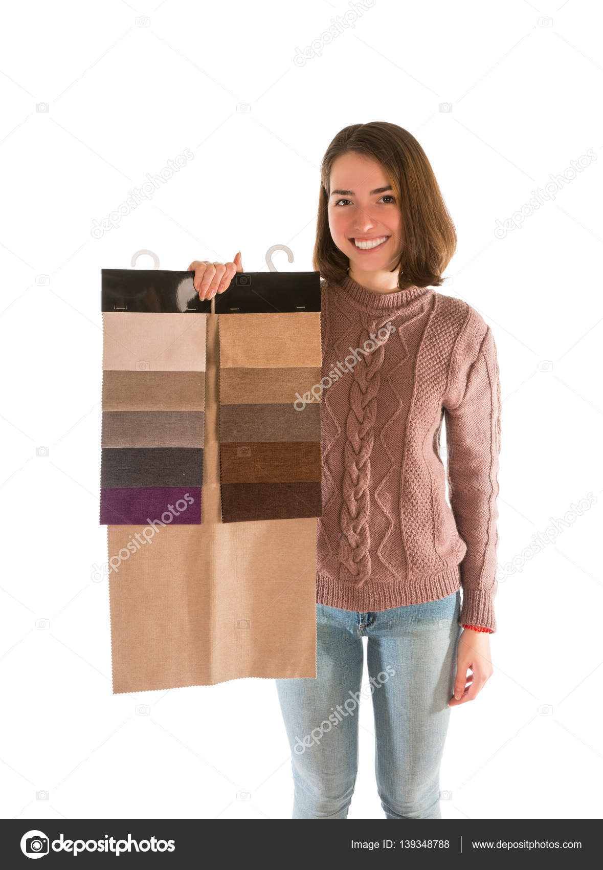 Smiling woman in sweater holding fabric swatches — Stock Photo ...