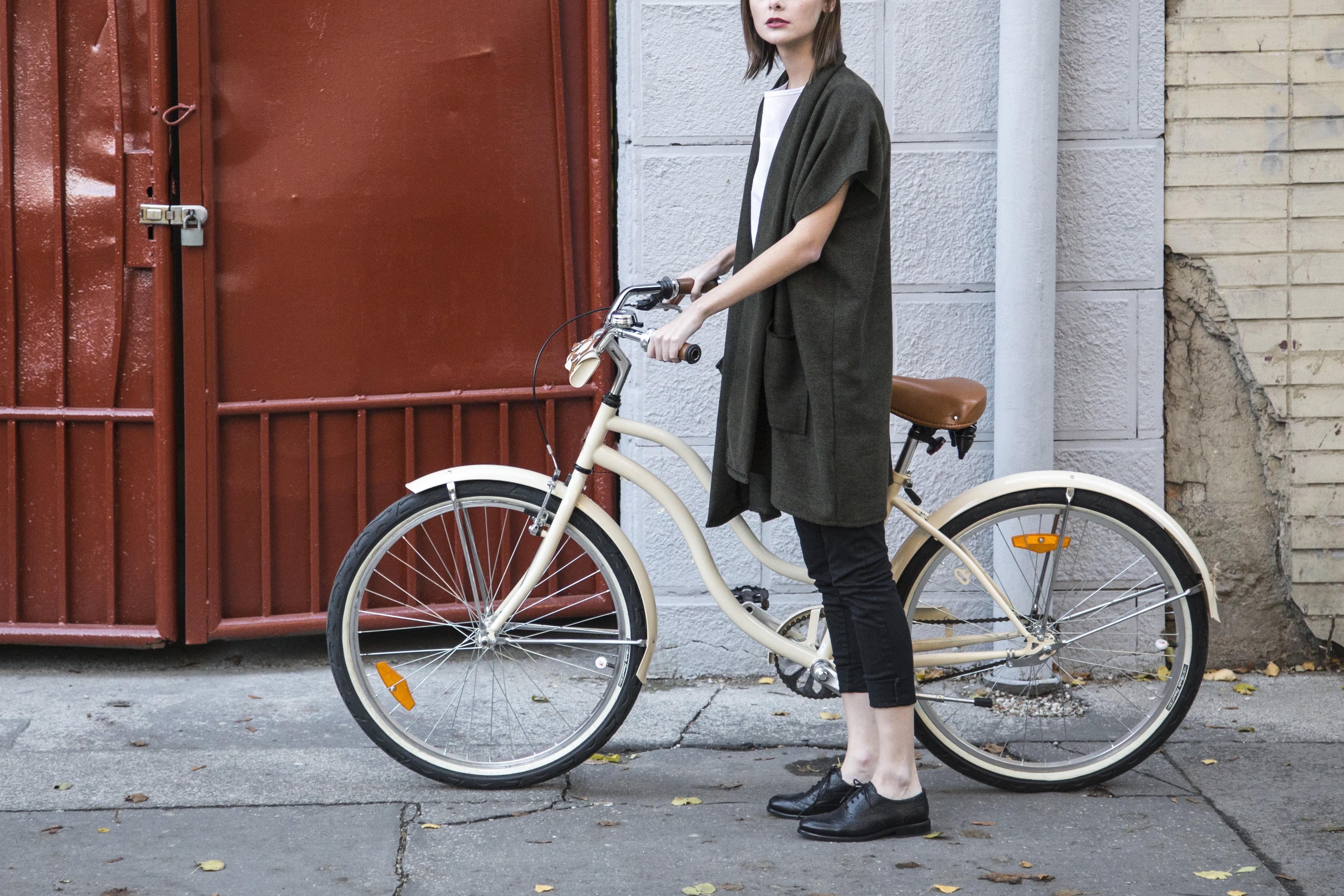 Woman standing beside cruiser bike near brown metal gate HD ...