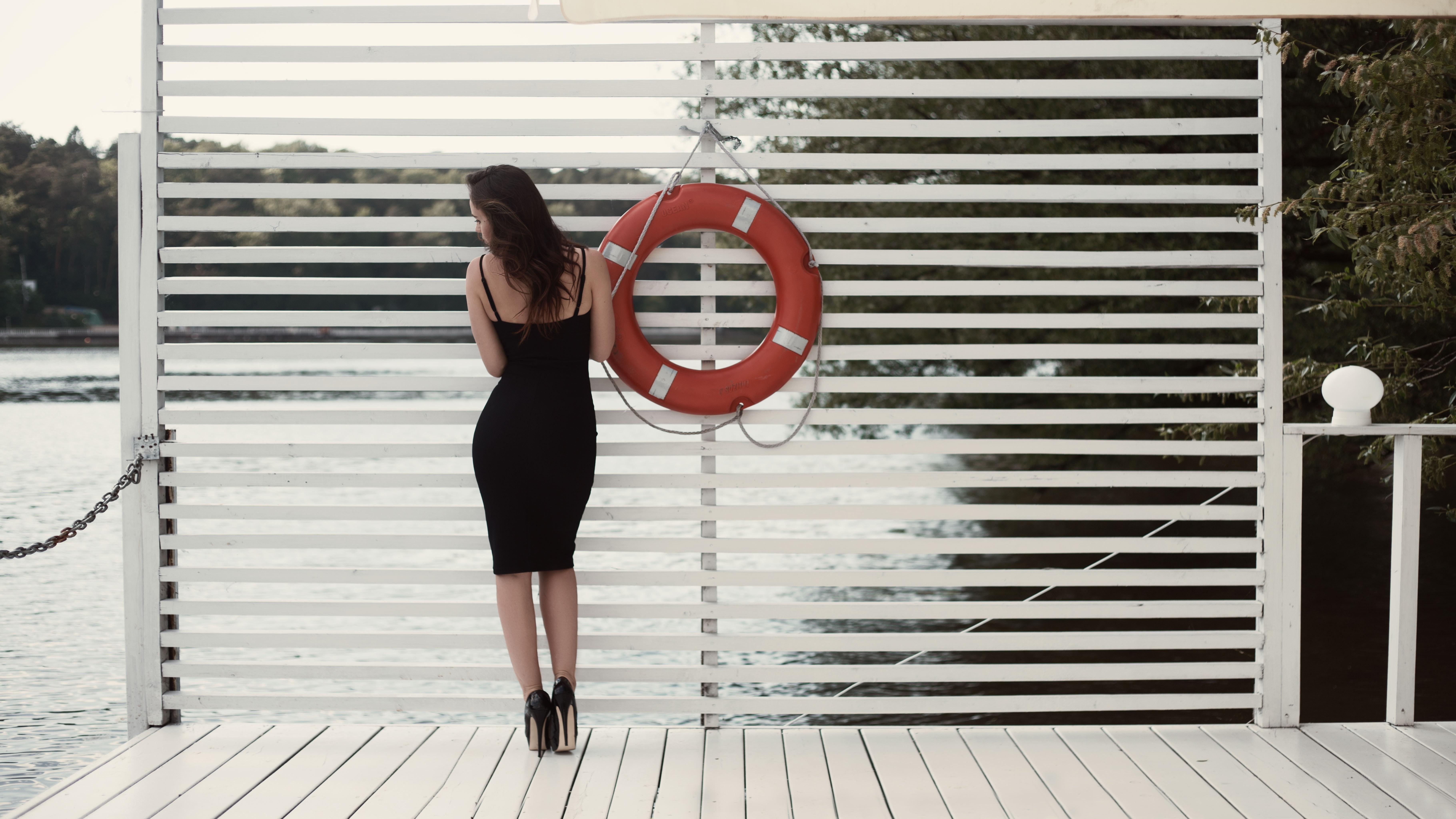 Woman in Black Sheath Dress Beside Swim Ring on Dock, Model, Young, Wooden flooring, Woman, HQ Photo