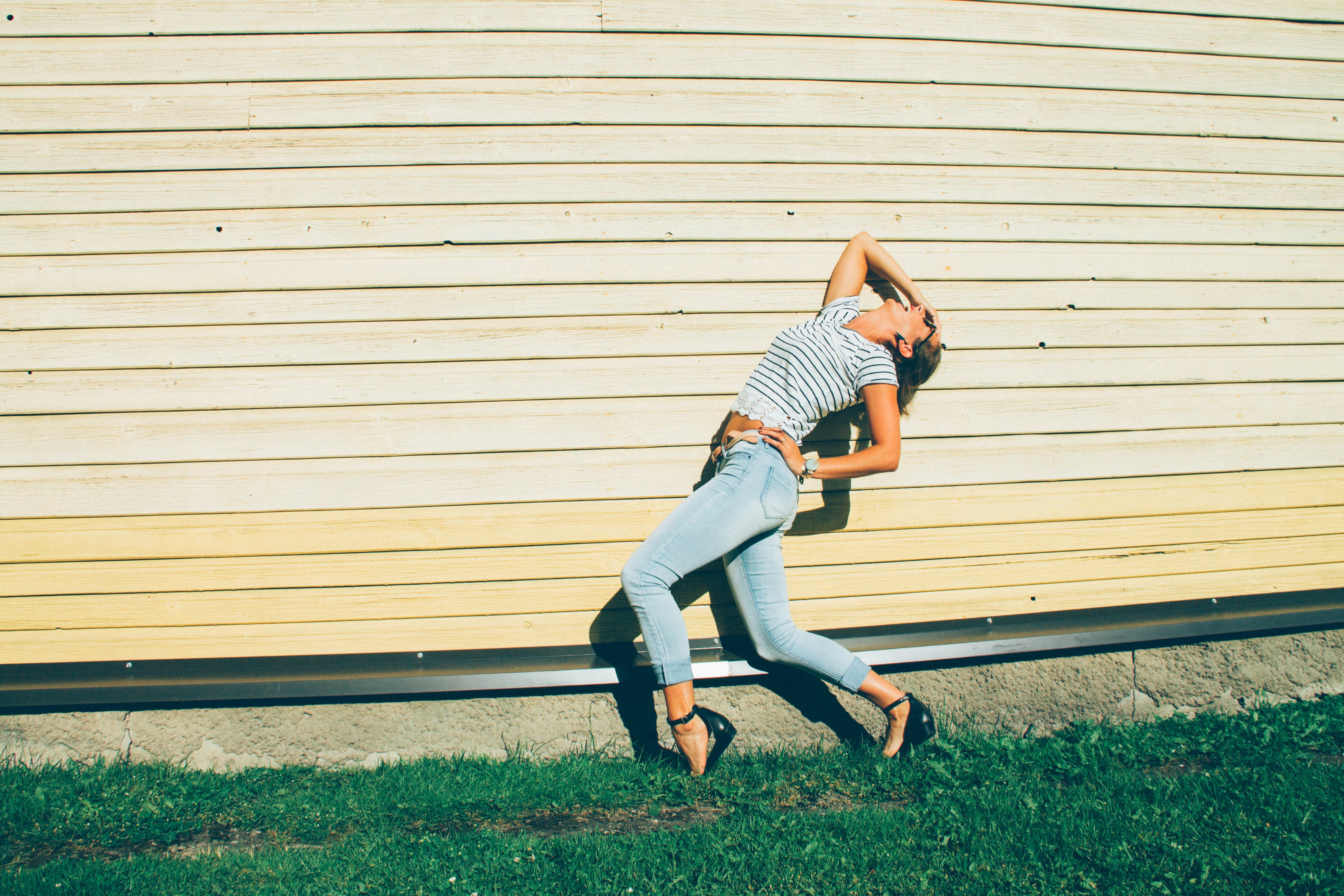 Woman in blue jeans and stripes crop top photo
