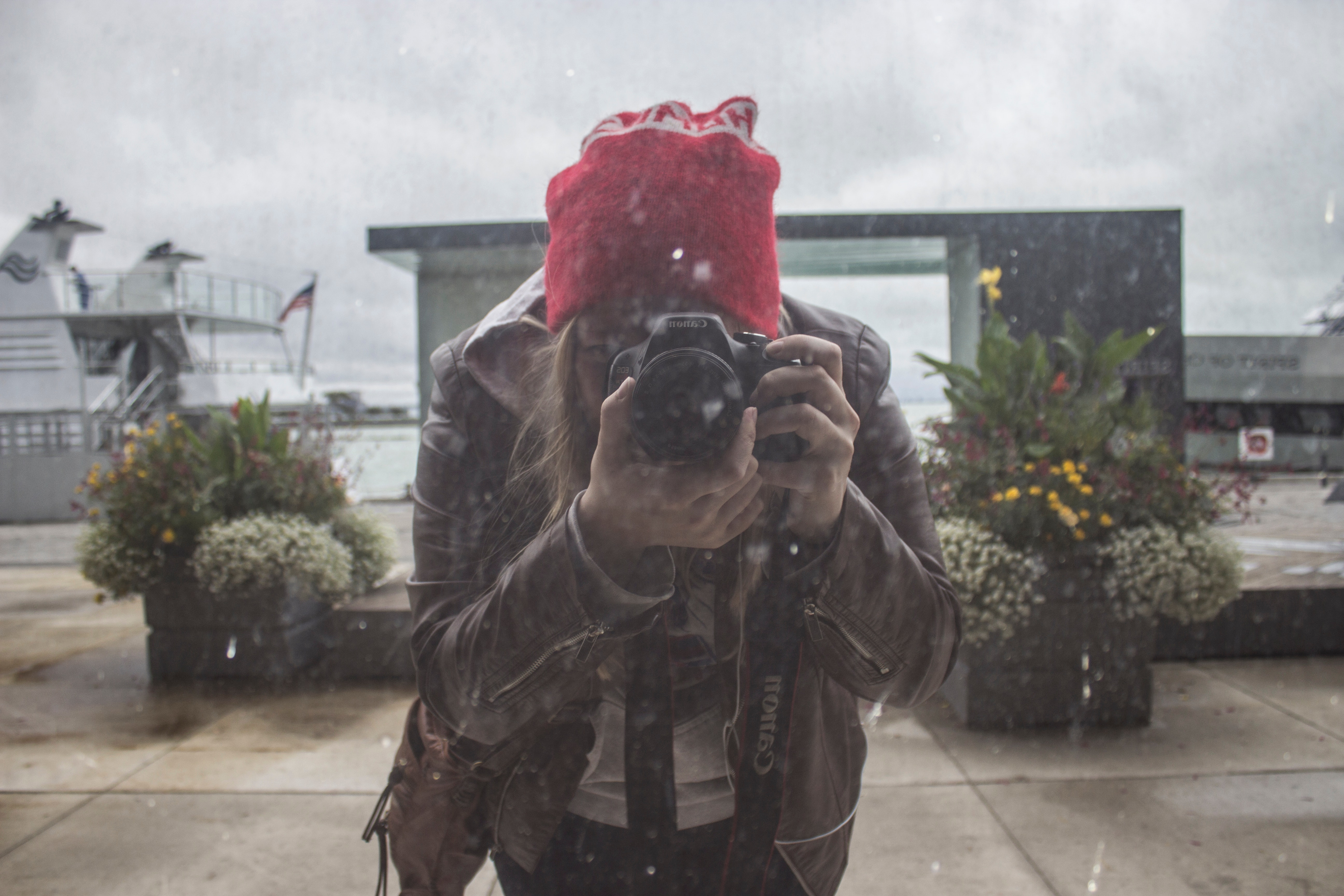 Woman in Brown Leather Jacket and Red Knit Cap Using Black Dslr Camera, Adult, Beanie, Blur, Camera, HQ Photo