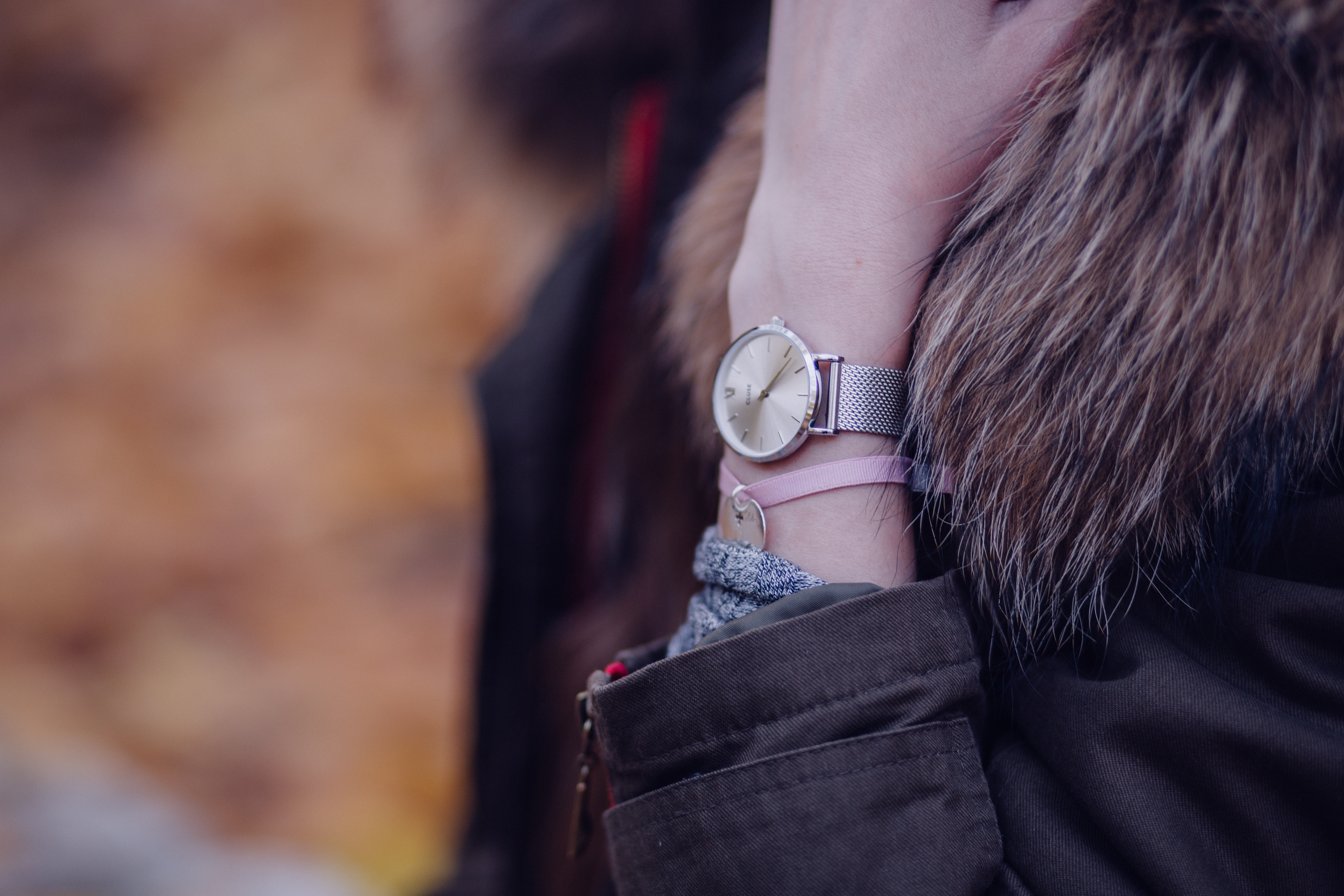 Woman in brown parka jacket with gold round analog watch photo