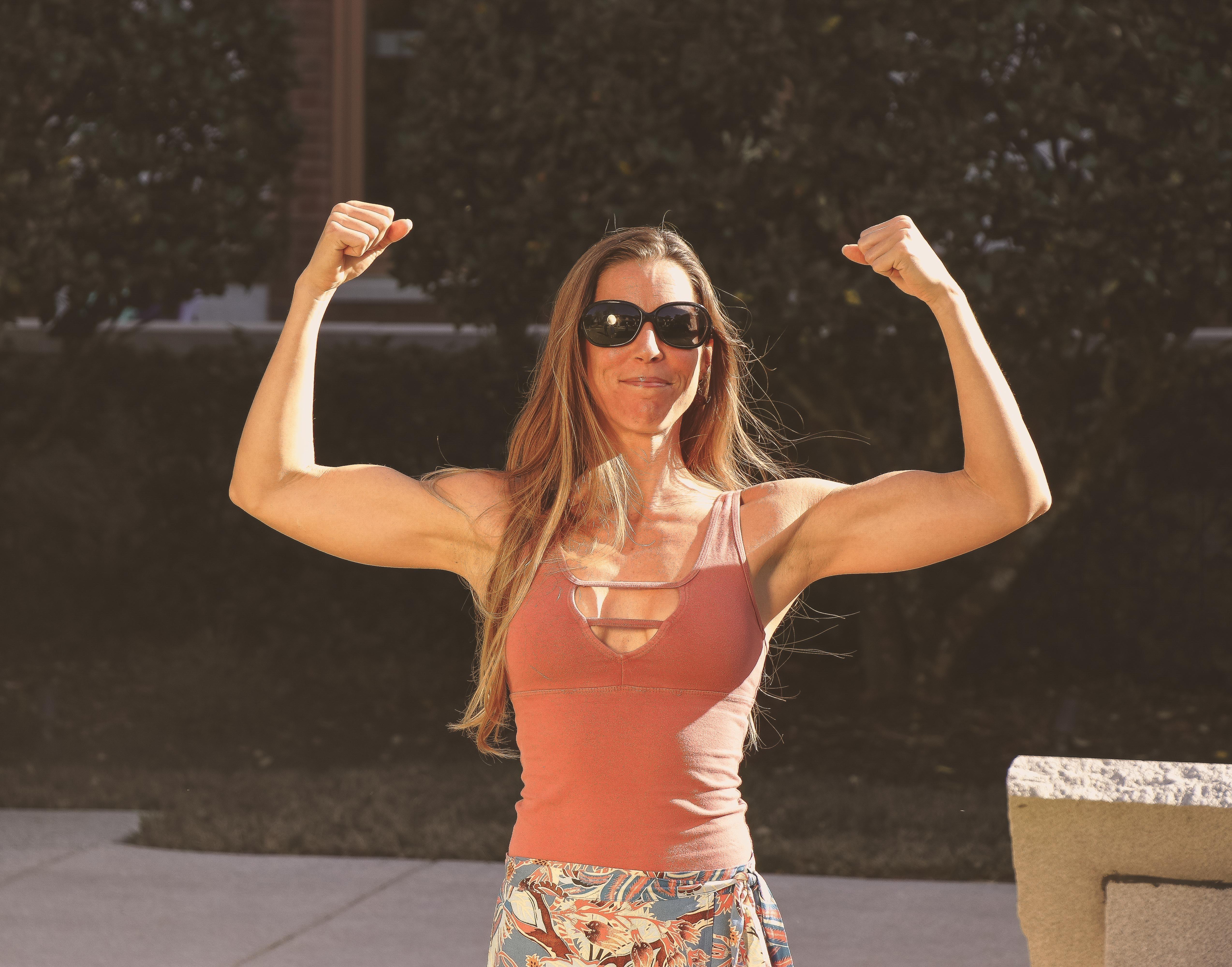 Woman in brown tank top photo