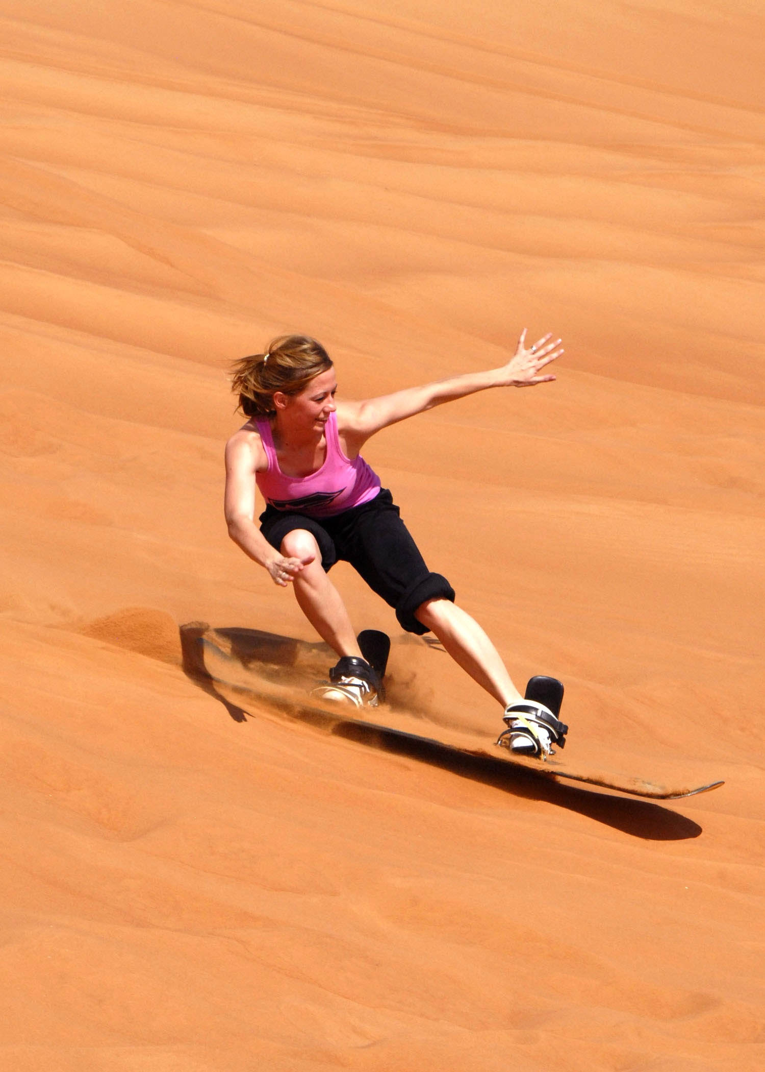 Woman in doing sun boarding during daytime photo