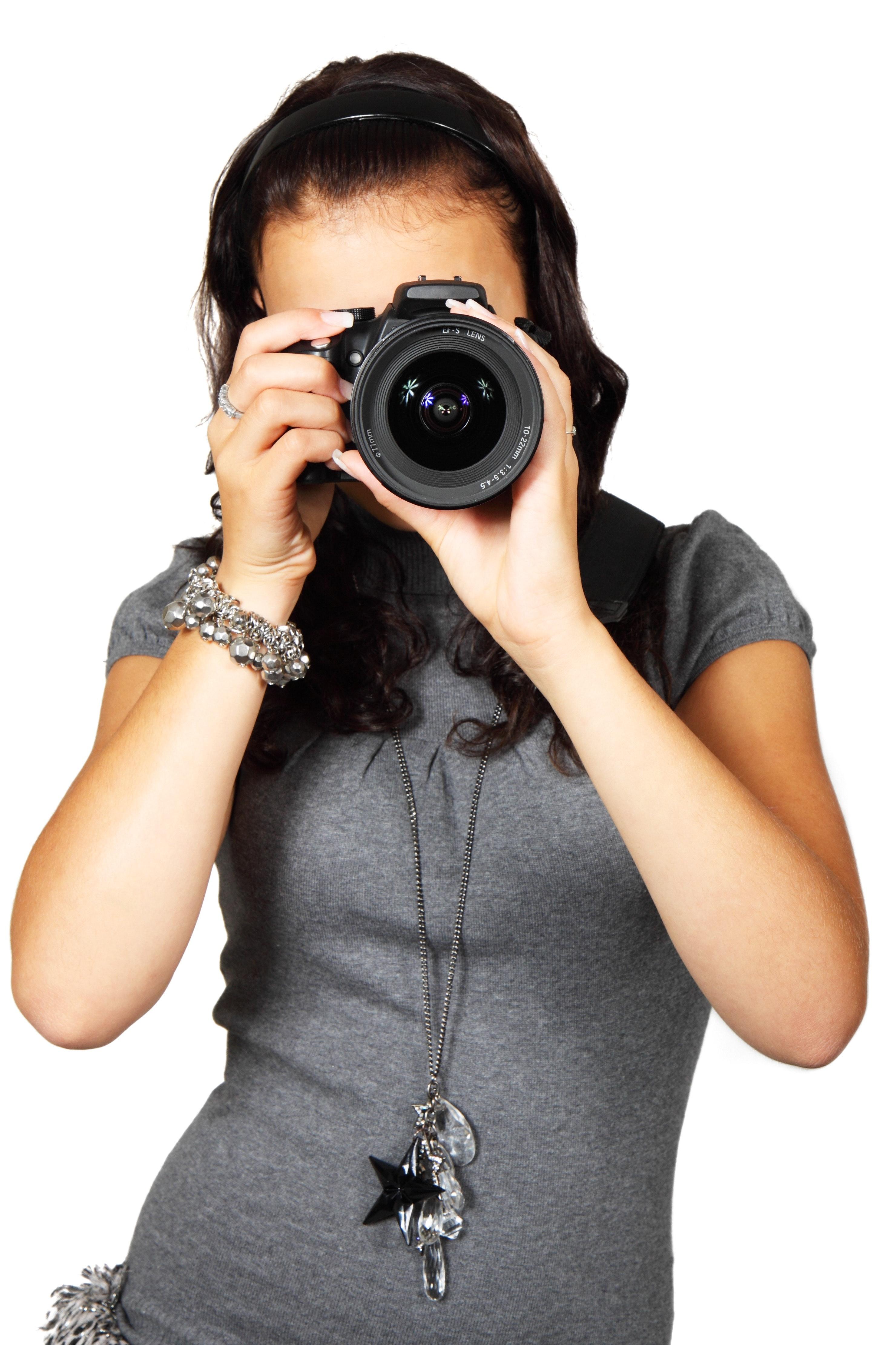Woman in grey t-shirt using black dslr camera photo