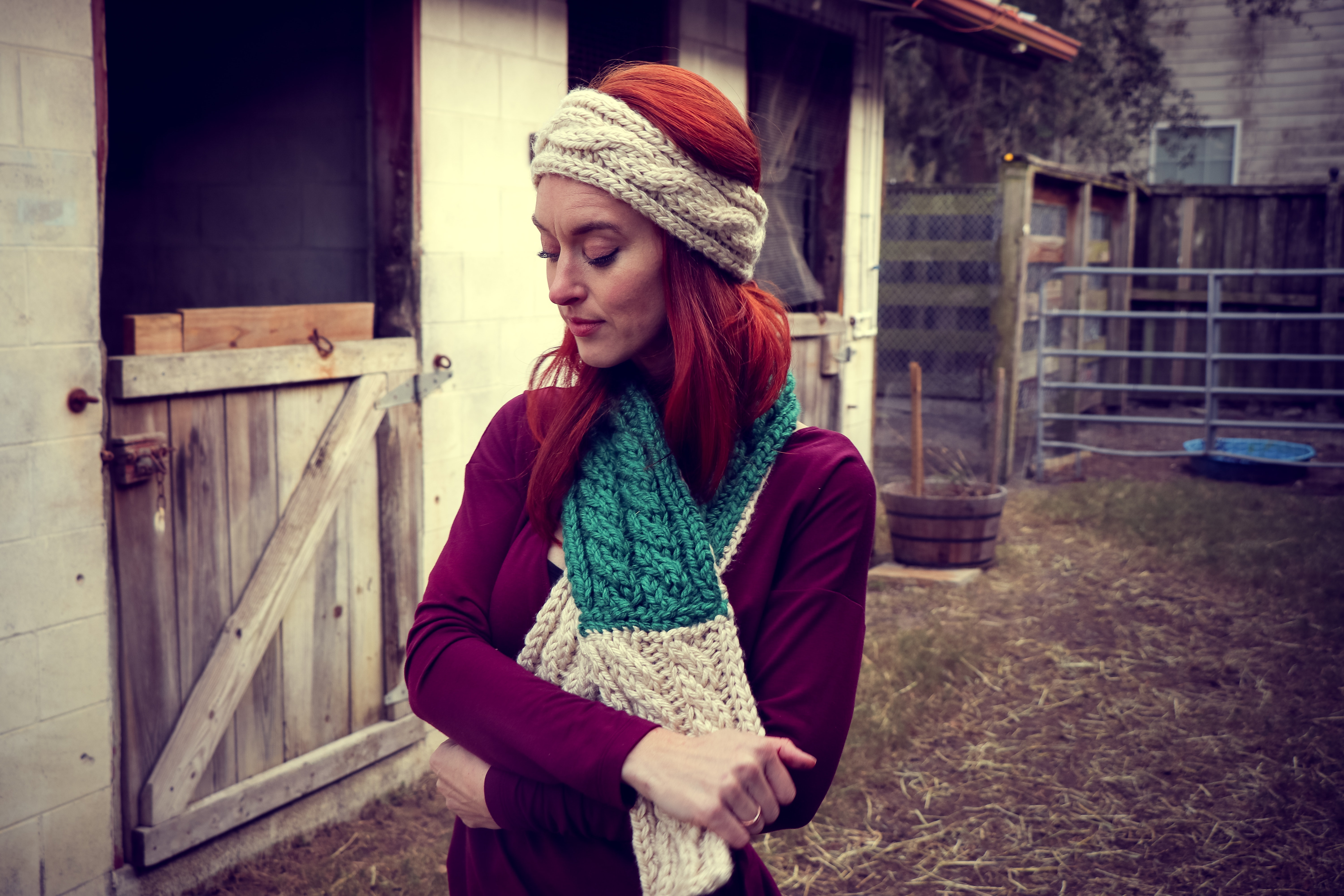 Woman in purple sweatshirt wearing knitted beanie and scarf photo