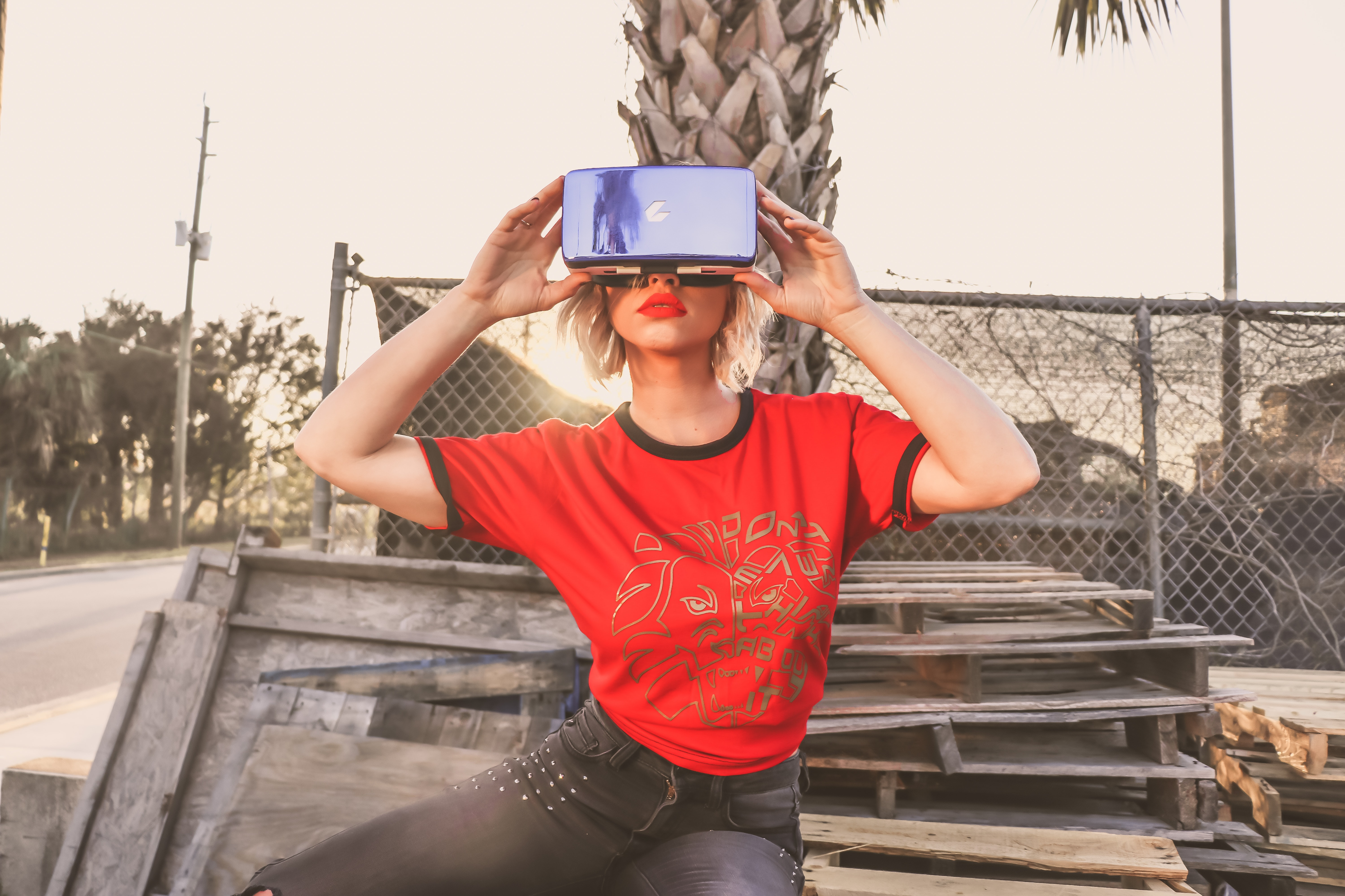 Woman in red crew-neck t-shirt wearing virtual reality glasses photo