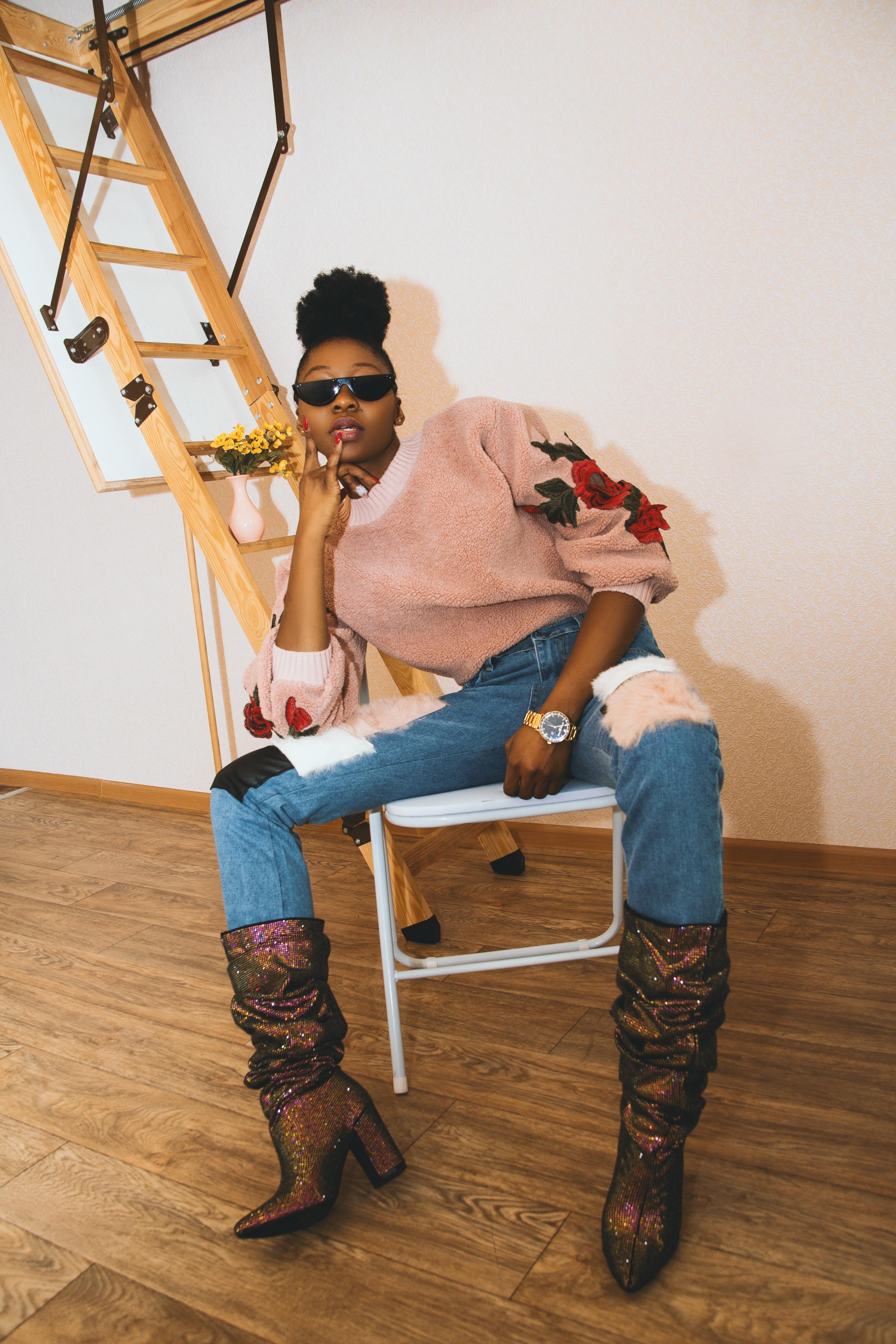 Woman in sweater sitting photo