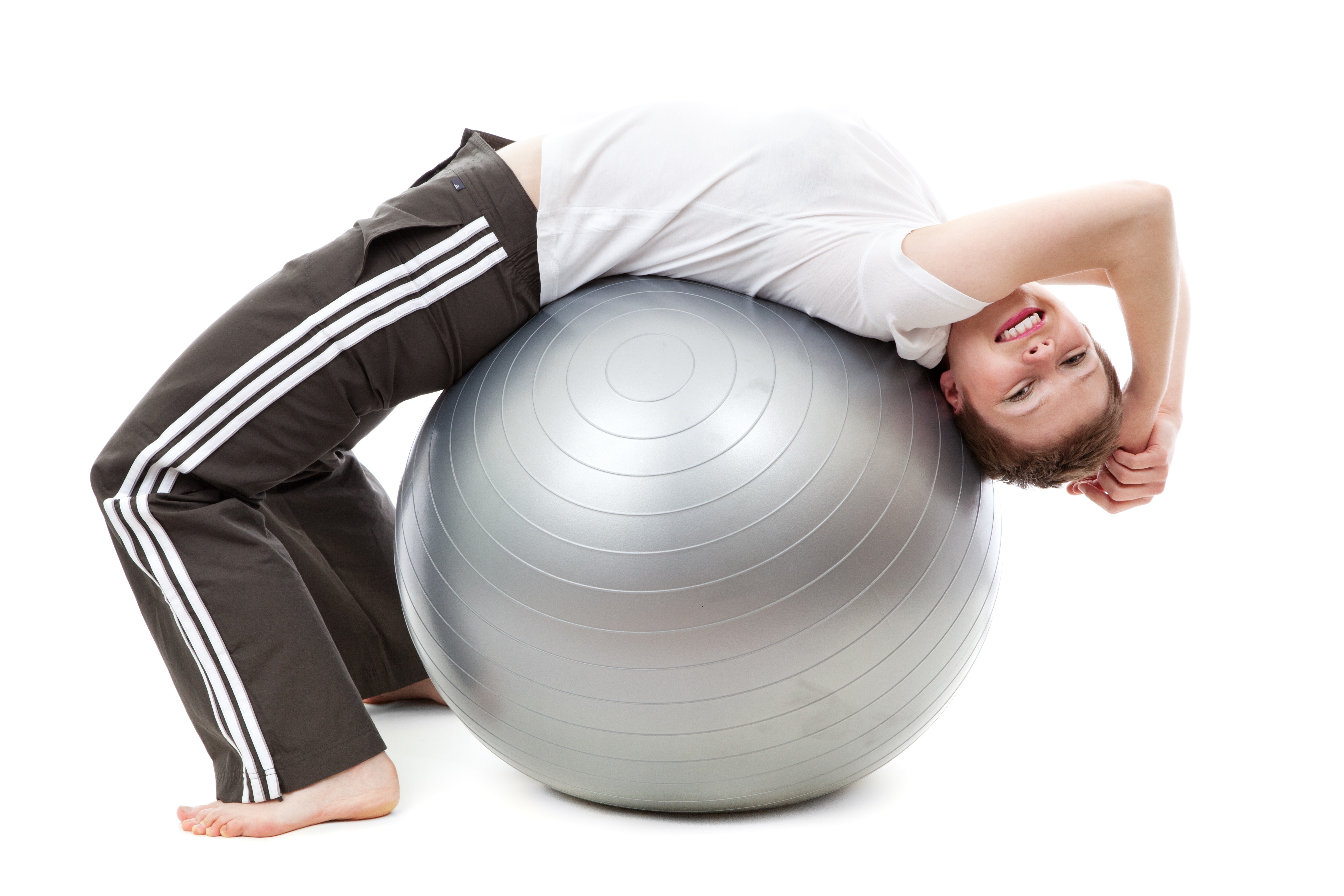 Woman in white cap shirt on stability ball photo