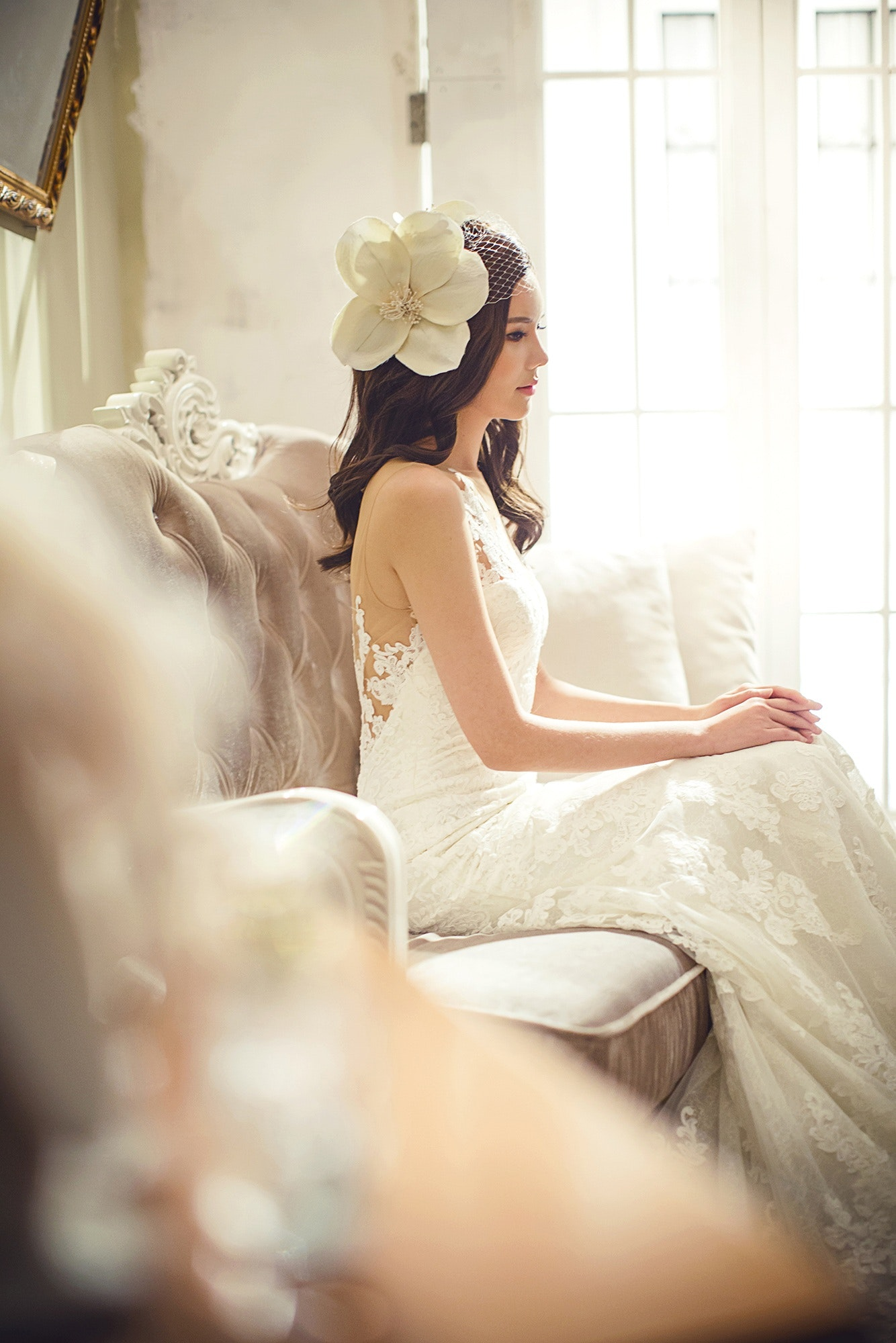 Woman in white floral wedding dress photo