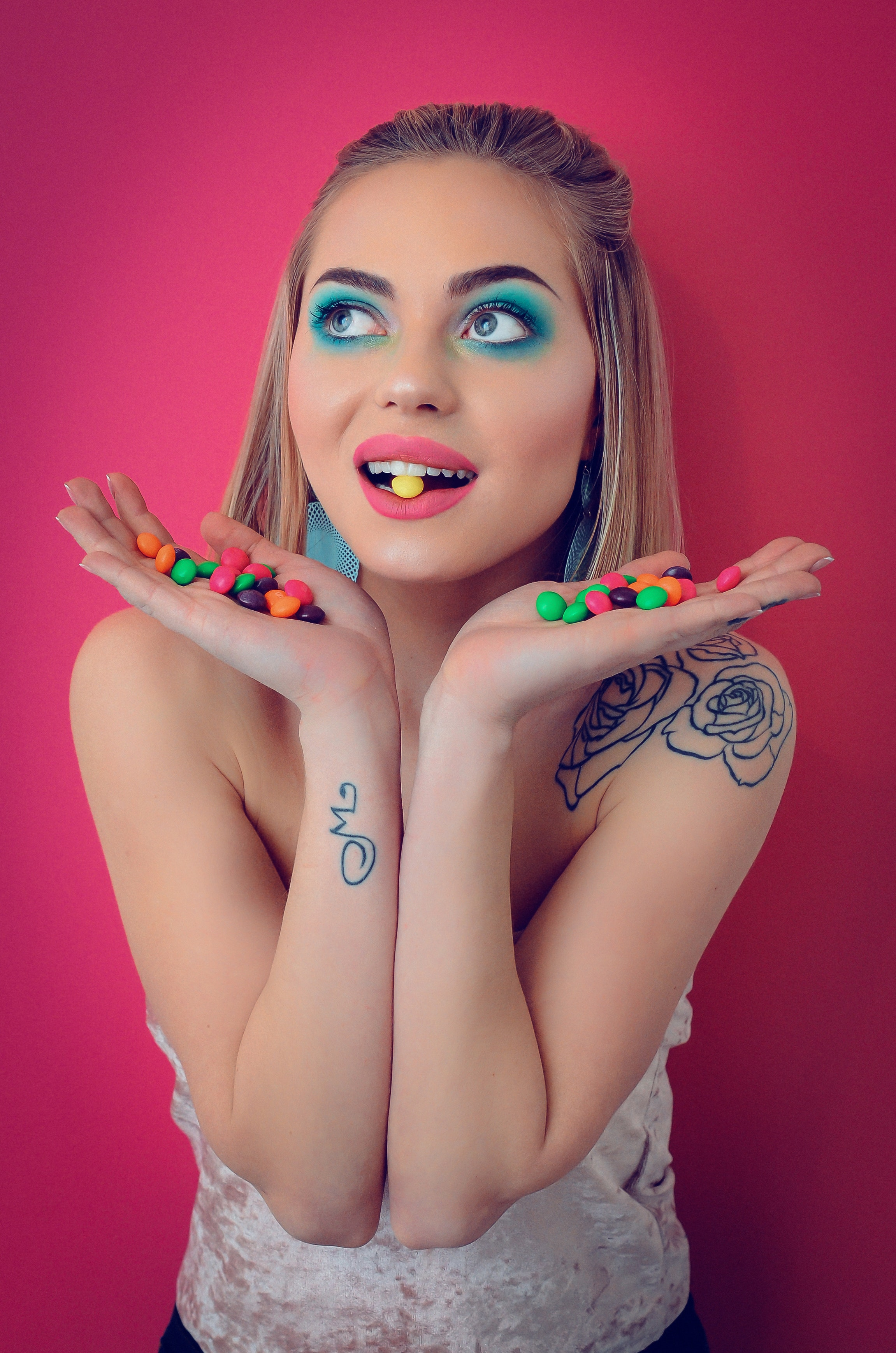 Woman in white shirt with candies on her hand photo