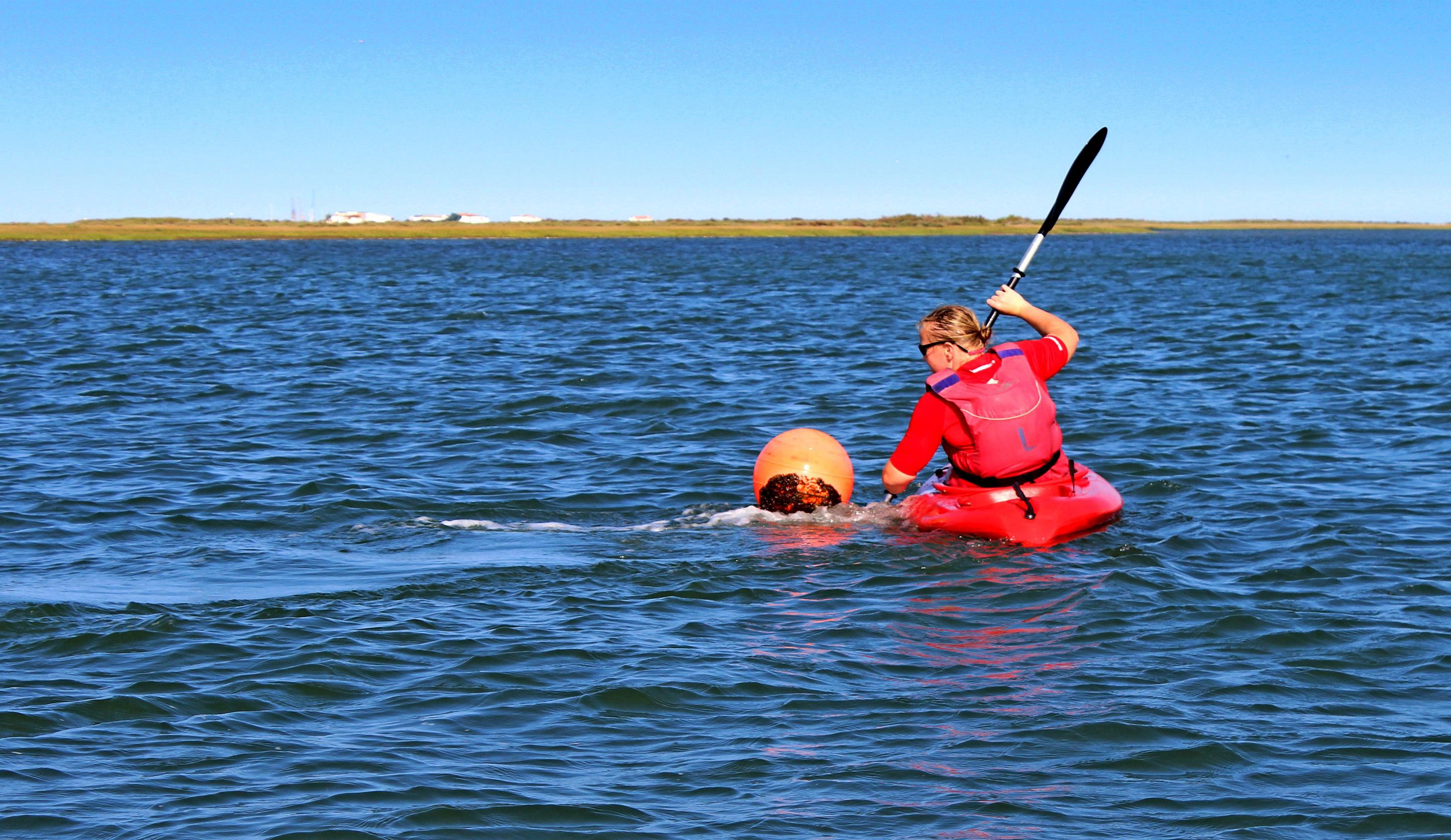 Woman kayaking photo