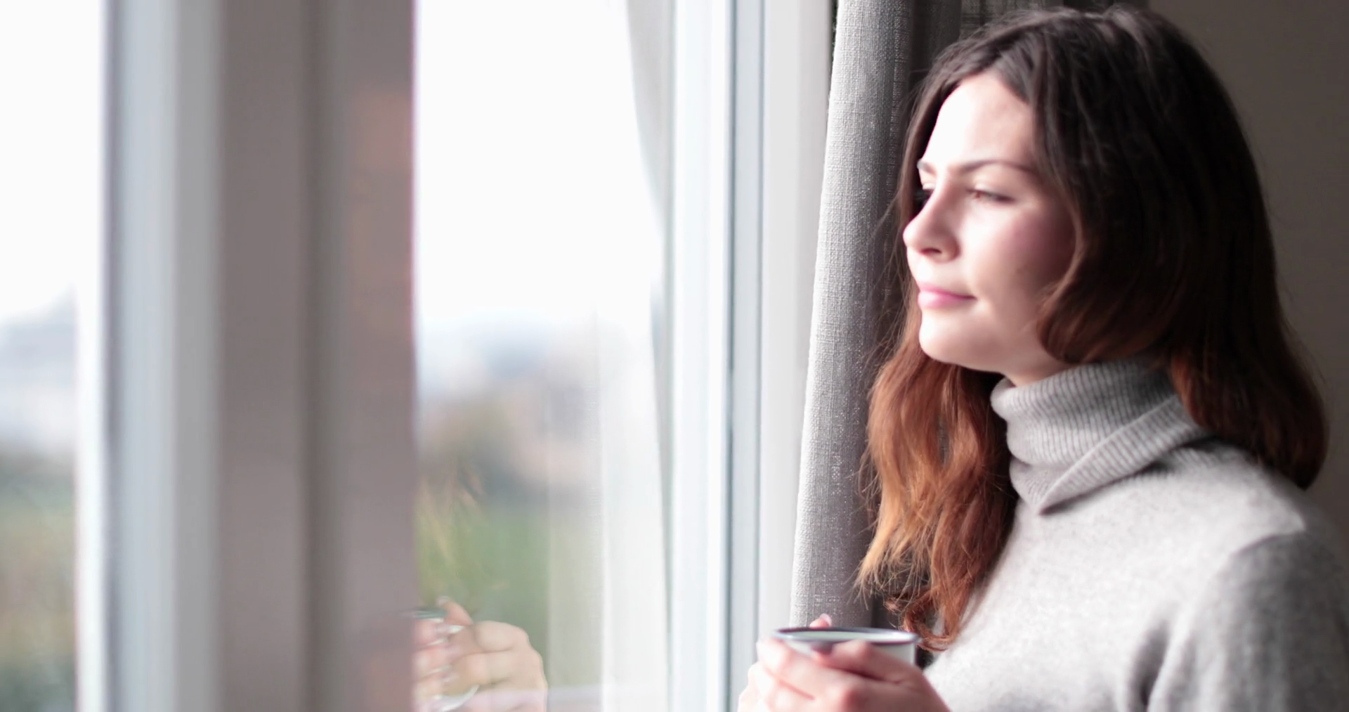 Woman looking out of window with morning coffee Stock Video Footage ...