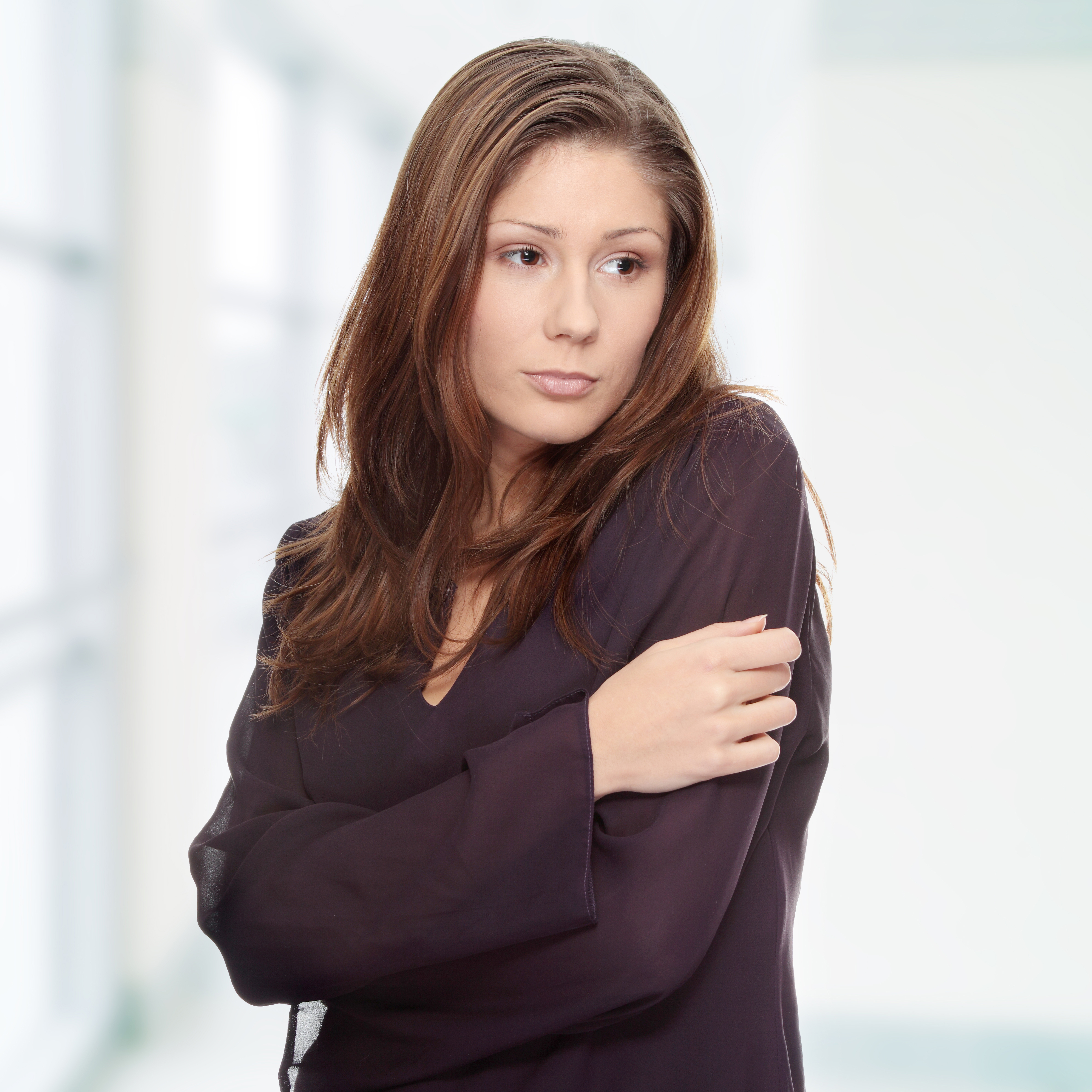 shutterstock_75450355 young woman looking depressed ...