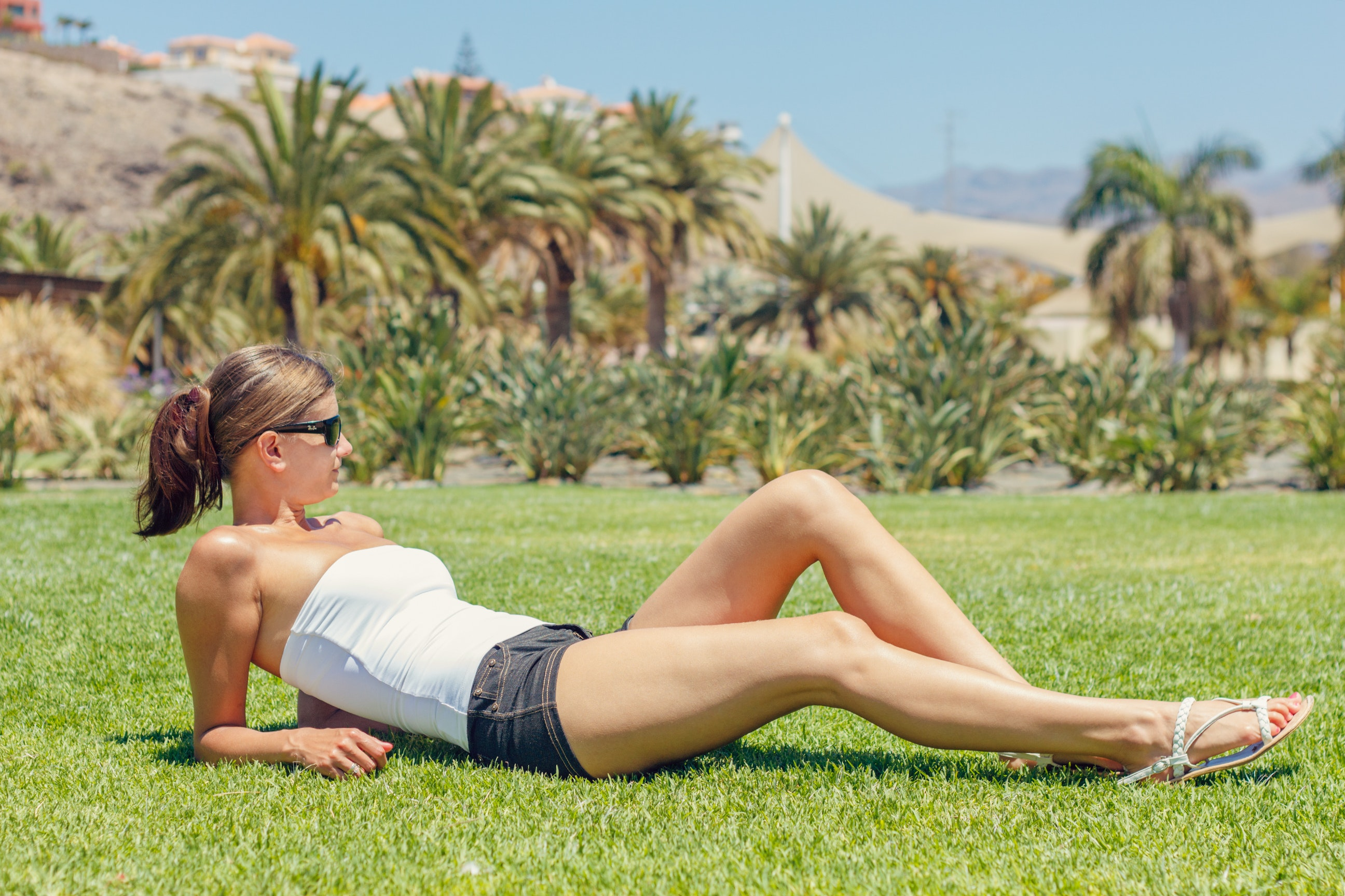 Woman lying on grass photo