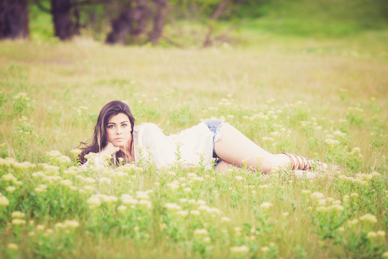 Woman lying on grass photo