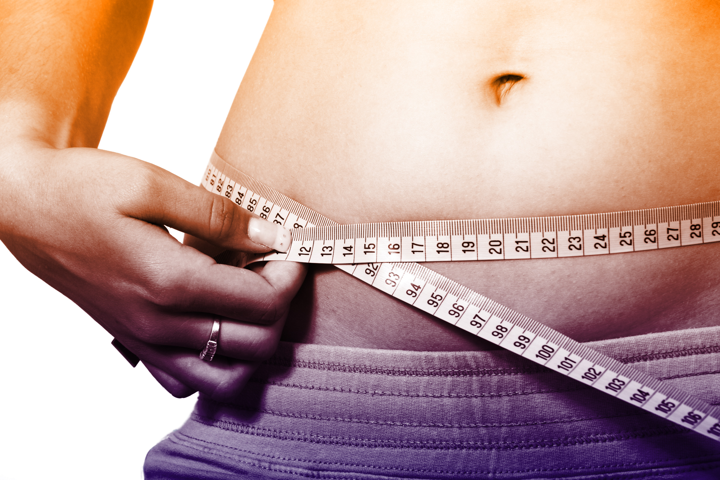 Woman measuring waistline - how to lose weight fast photo