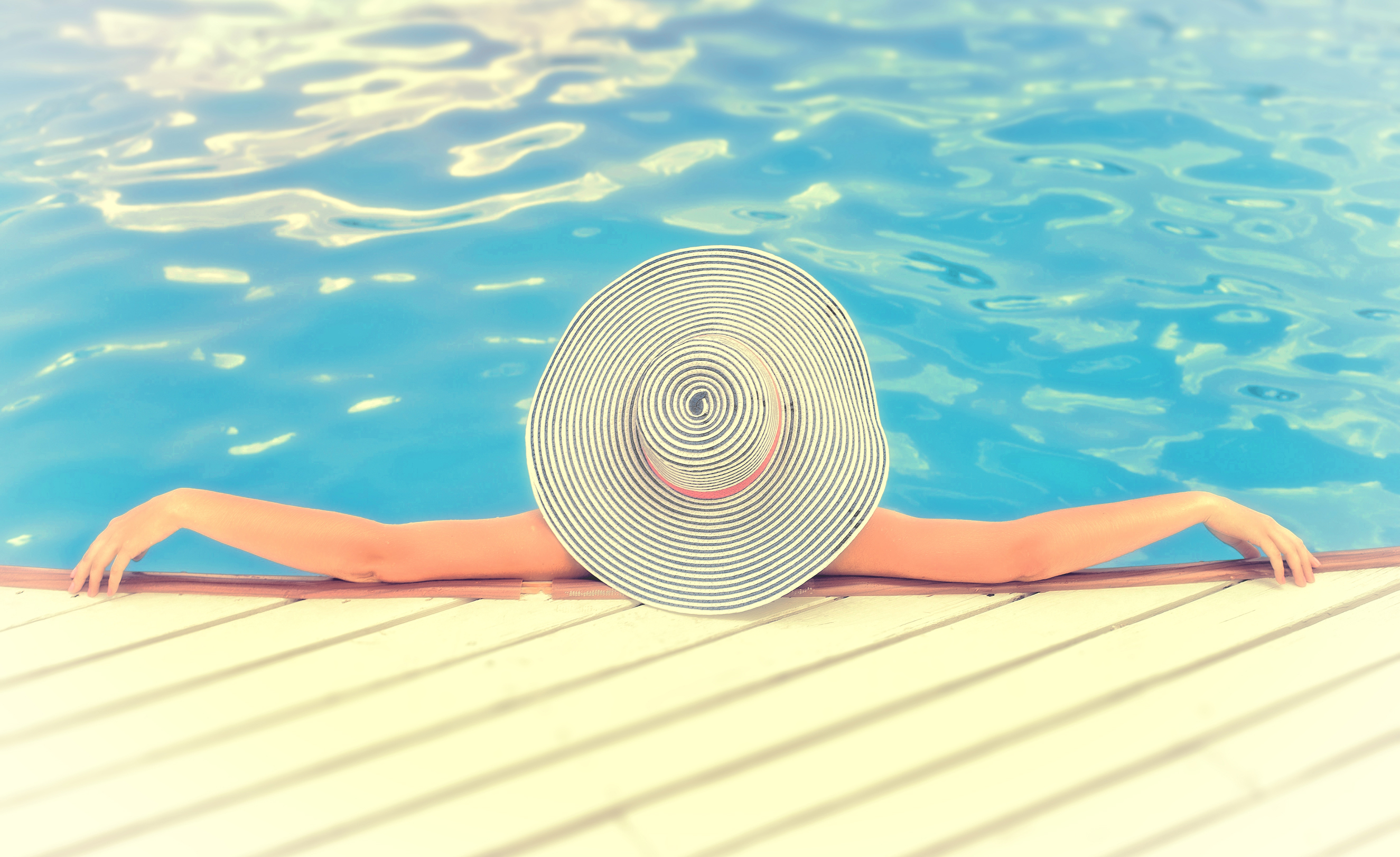 Woman on vacations with hat relaxing -swimming pool photo
