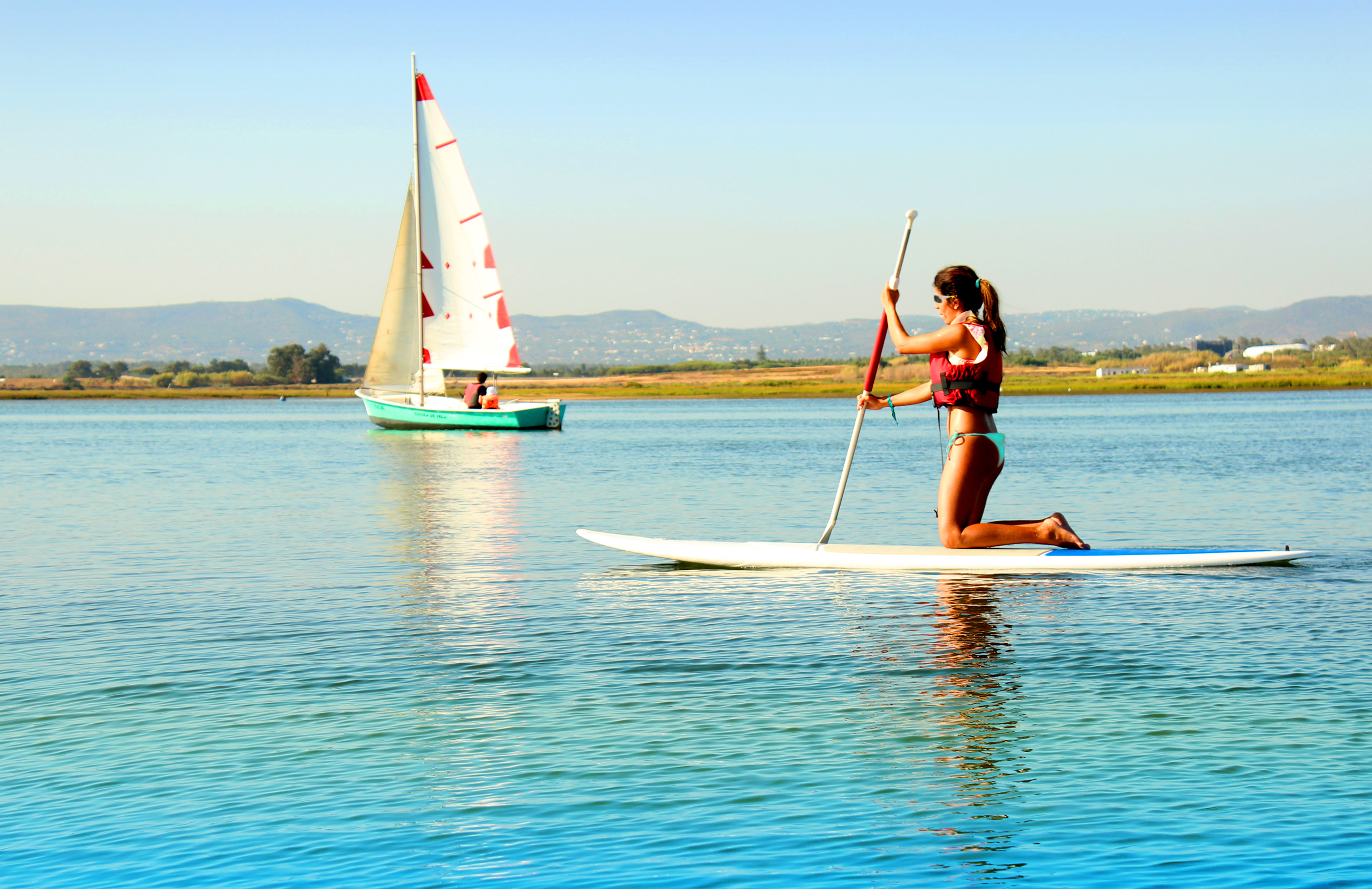 Woman practicing stand-up paddle photo