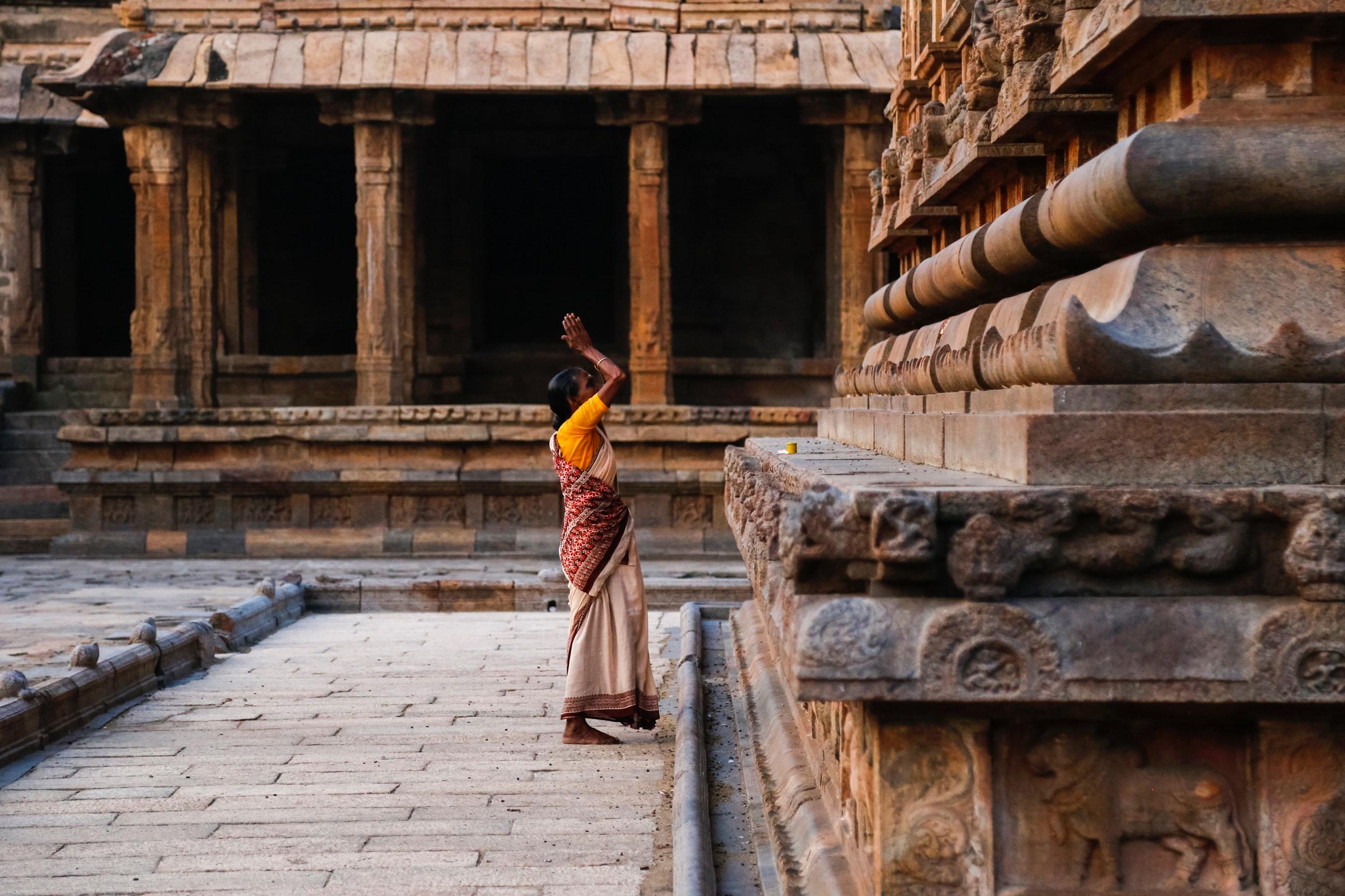 Woman praying on wailing wall photo
