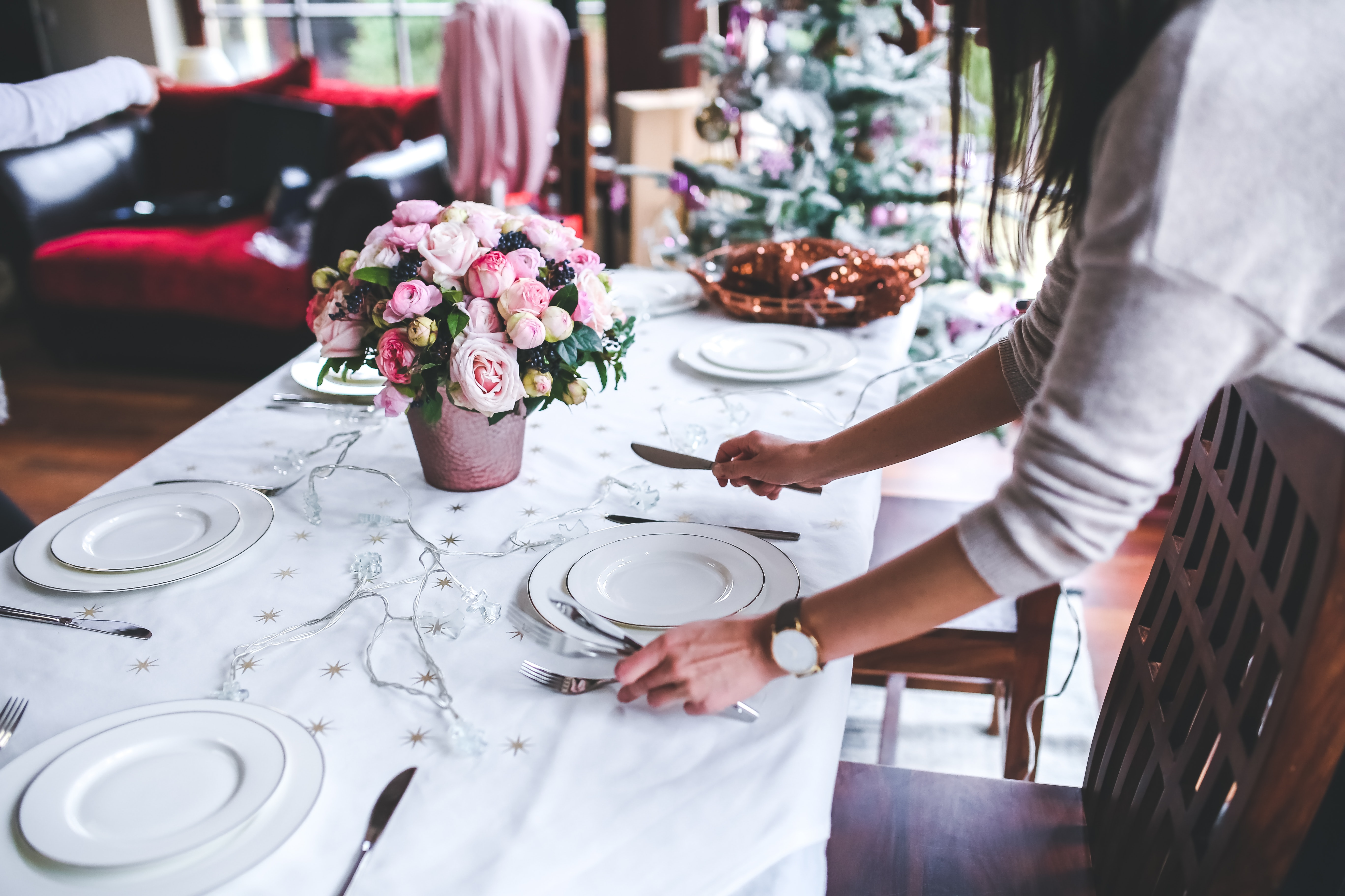 Woman preparing christmas table photo