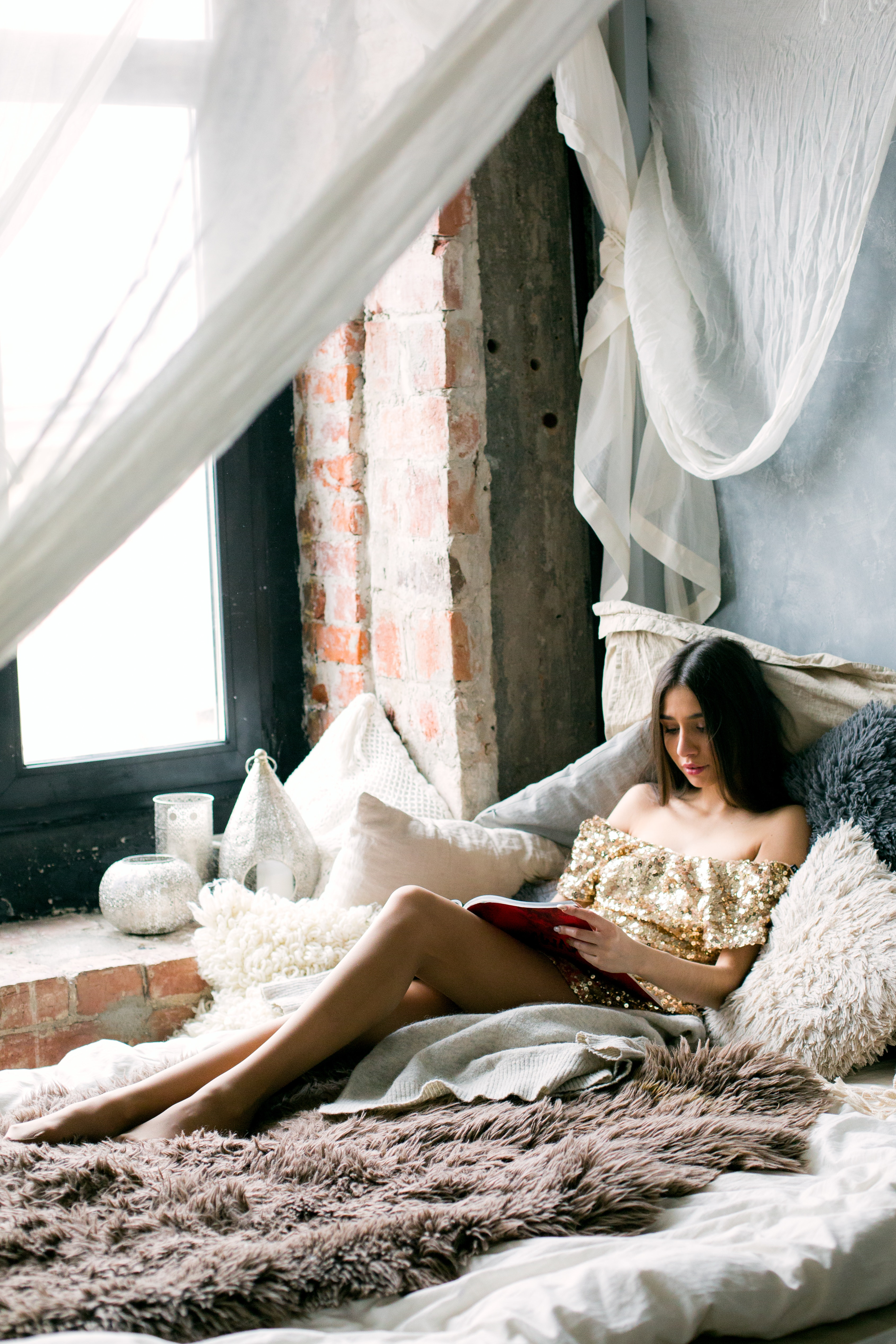 Woman reading a book in the bed photo