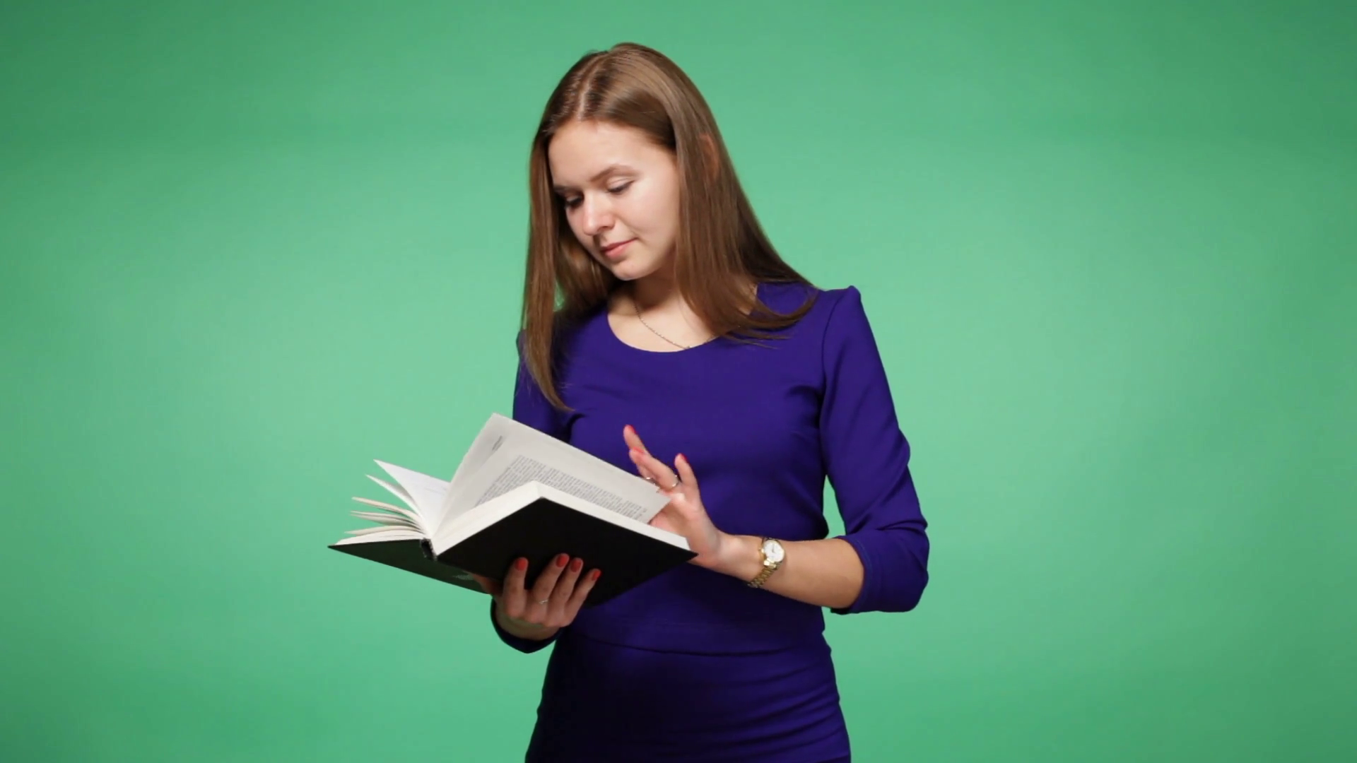Young woman reading a book, chroma key green screen background Stock ...