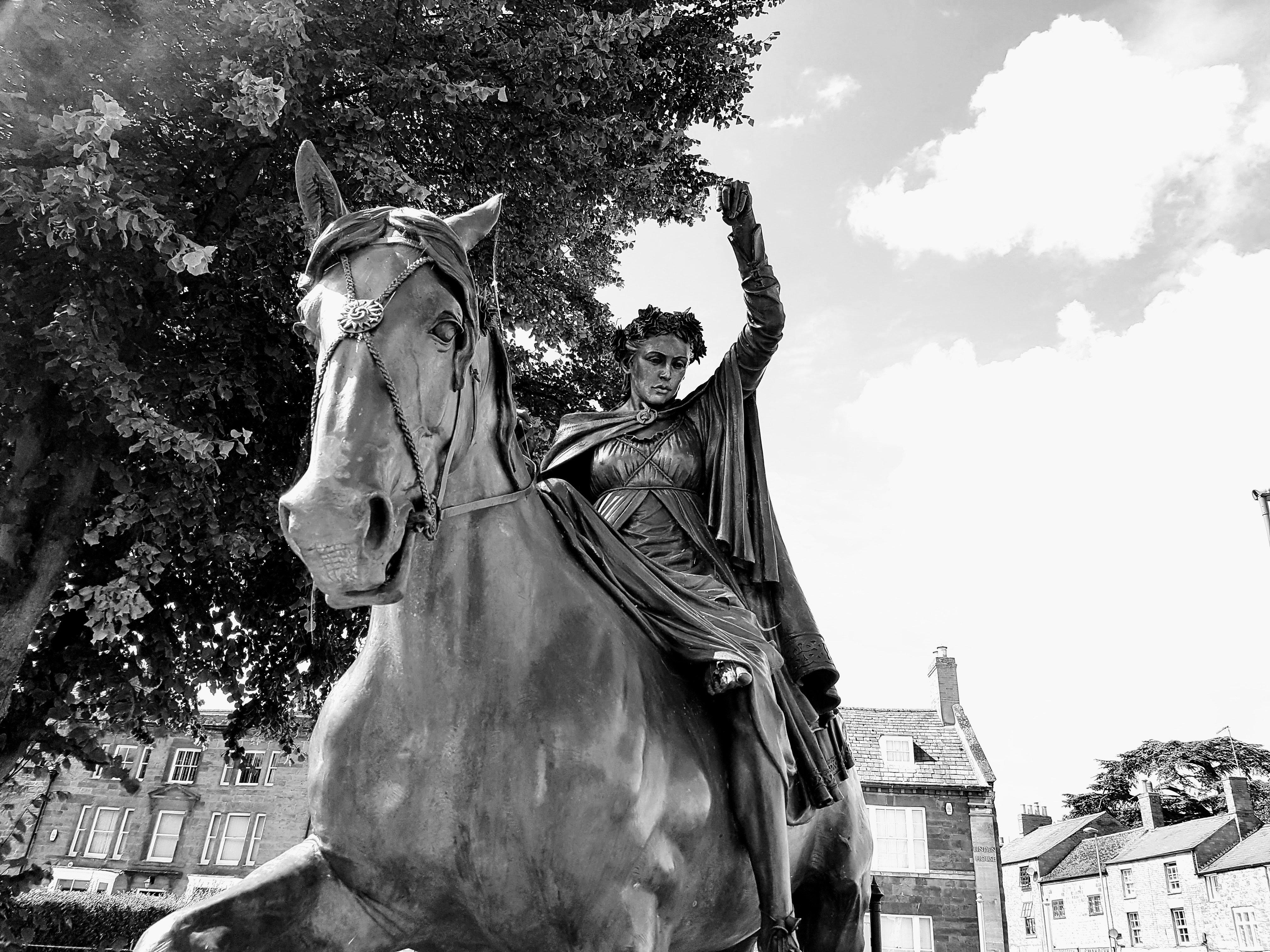 Woman riding horse statue photo