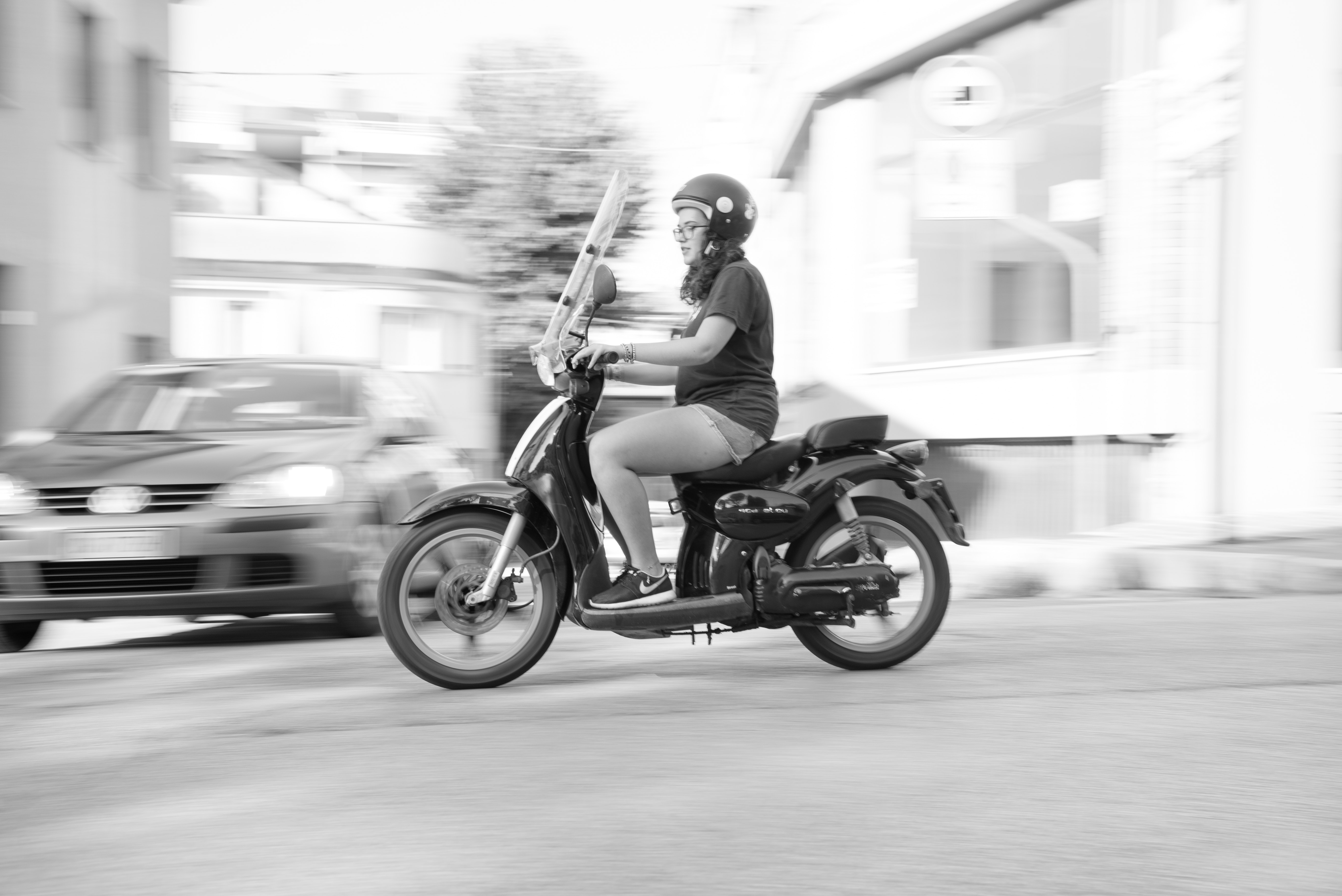 Woman riding on scooter motorcycle photo