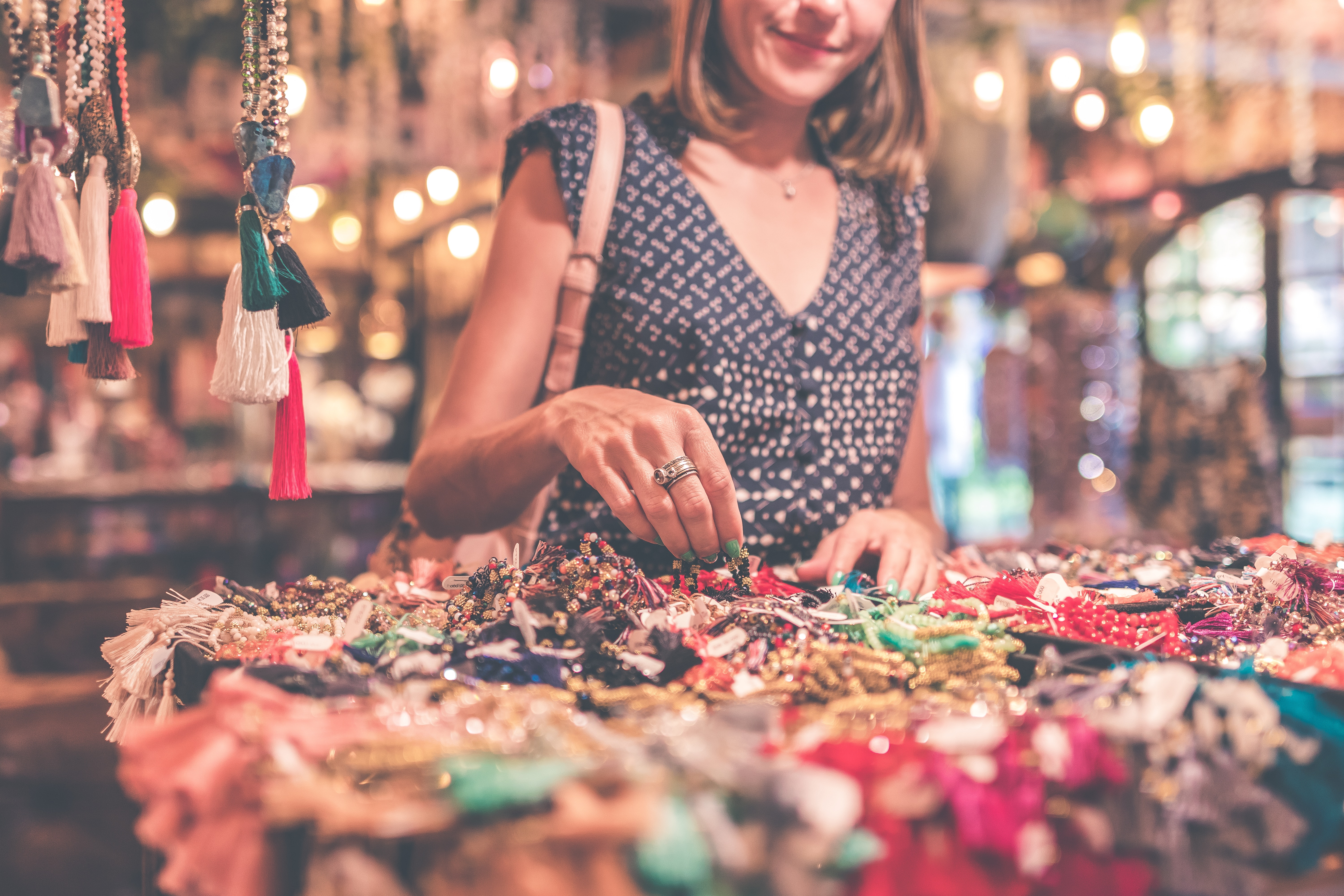 Woman selecting beaded jewelry photo