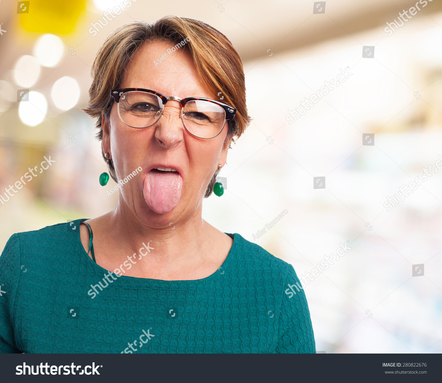 Woman showing her tongue photo
