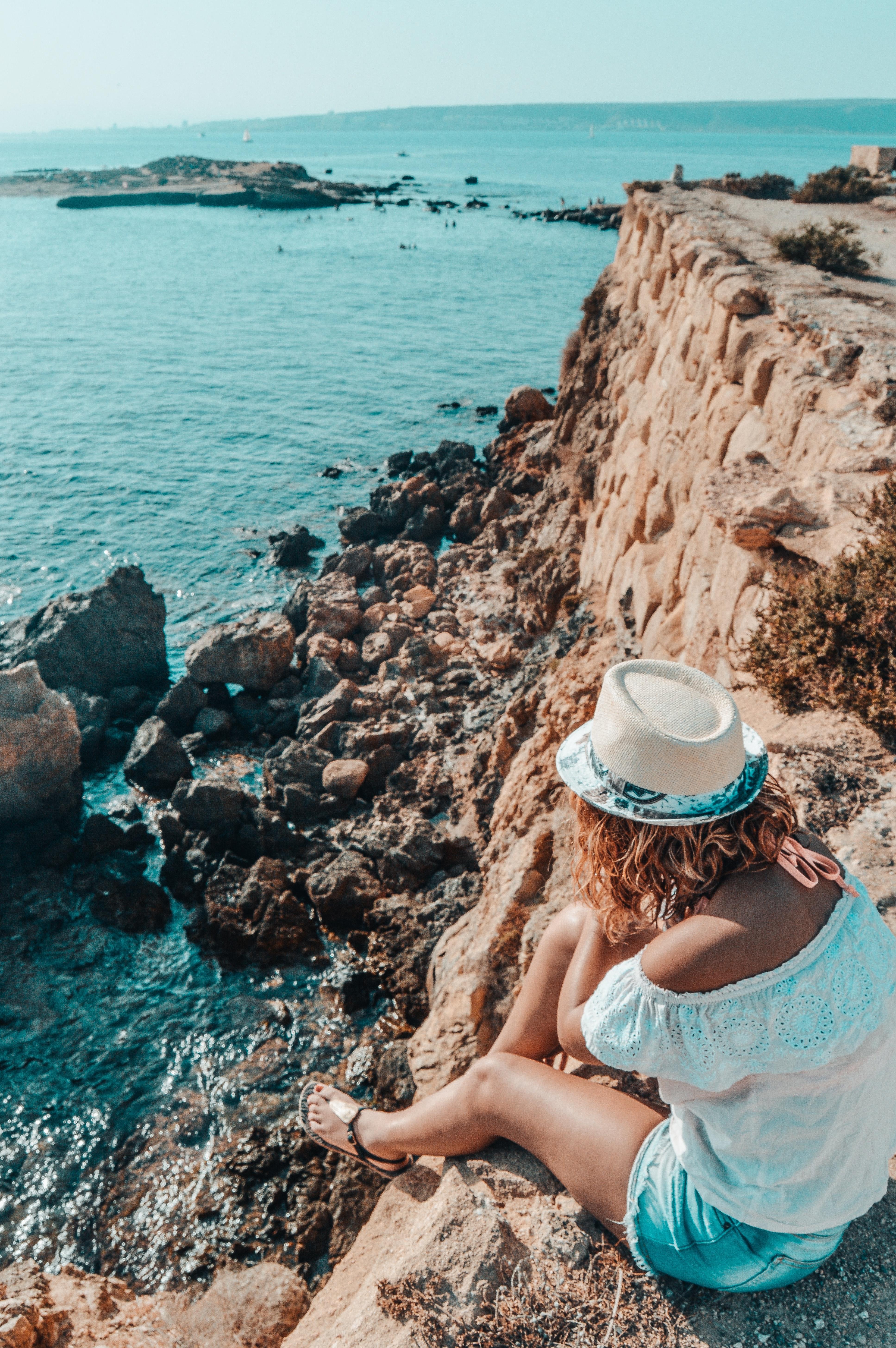 Woman Sitting in Stone Near Body of Water, Beach, Rocks, Waves, Water, HQ Photo