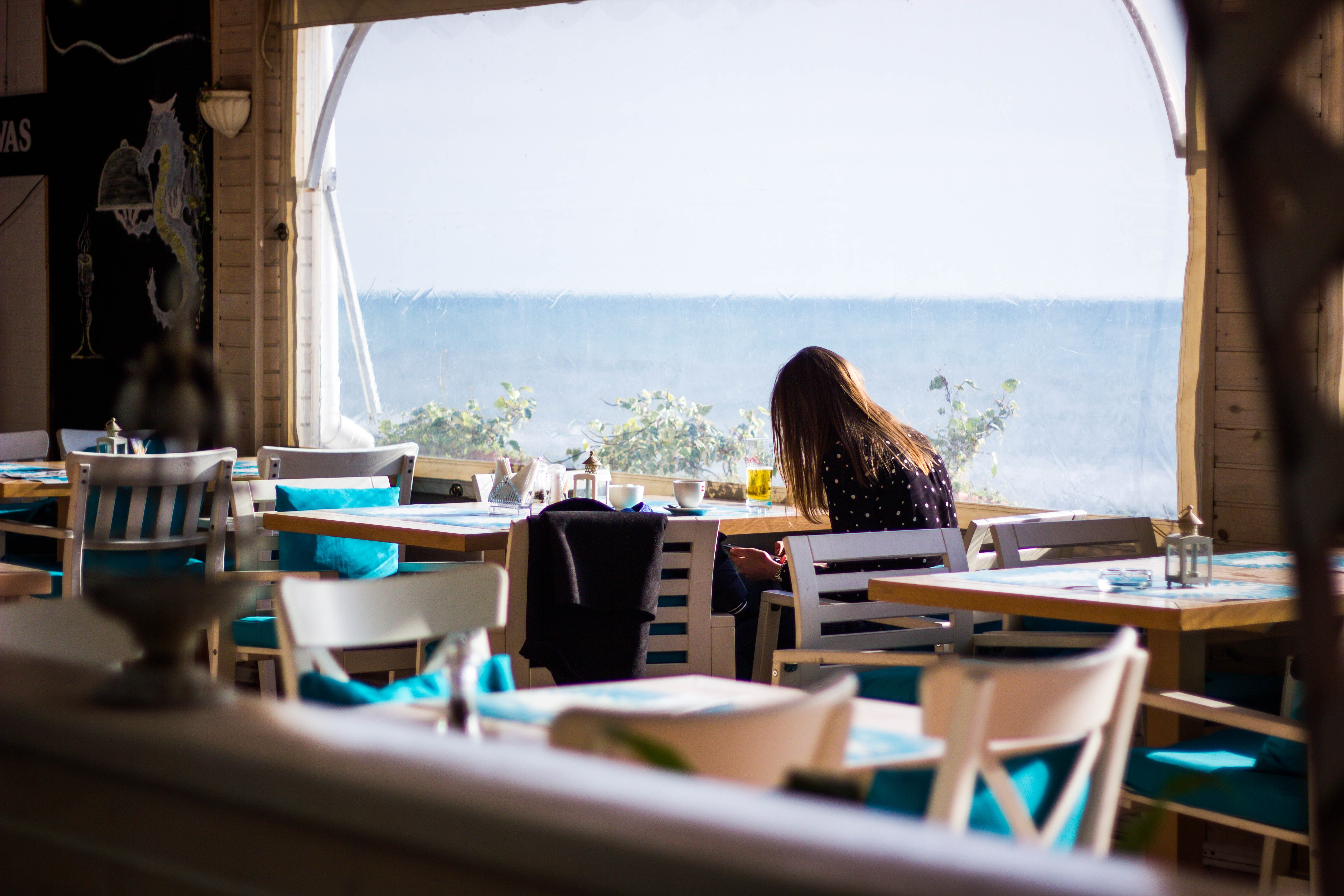 Woman Sitting on Chair With View of Sea, Beach, Sea, Wooden chairs, Window, HQ Photo