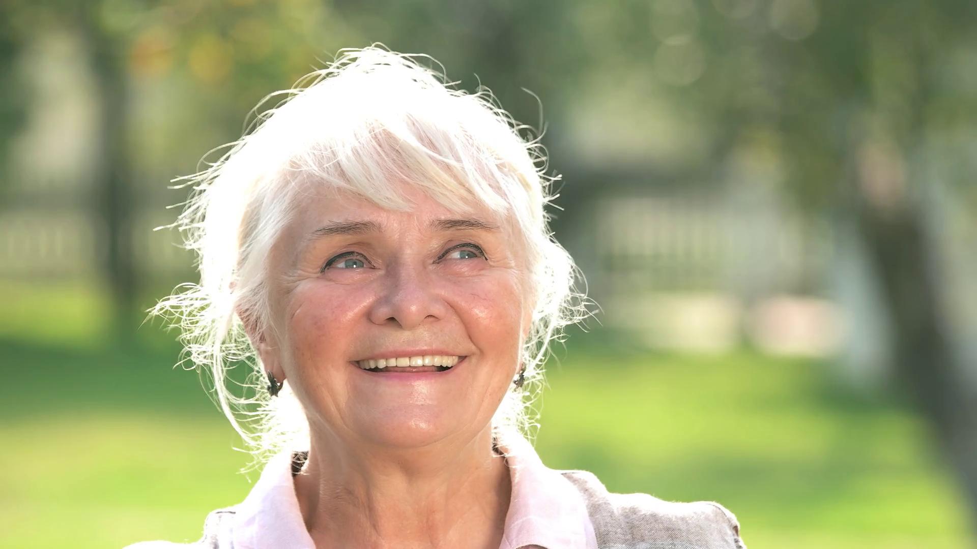Thoughtful senior woman smiling. Joyful old lady. Basics of positive ...