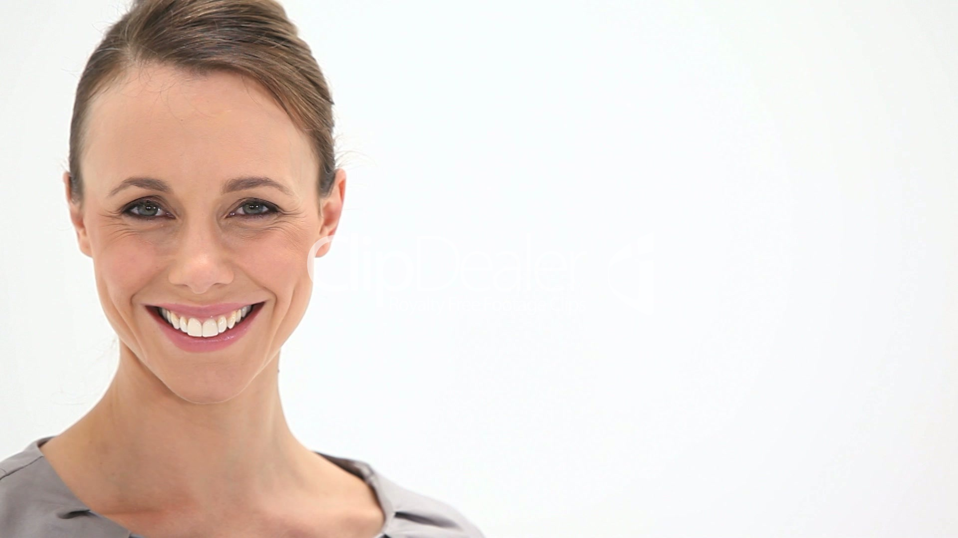 Smiling woman looking at camera: Royalty-free video and stock footage