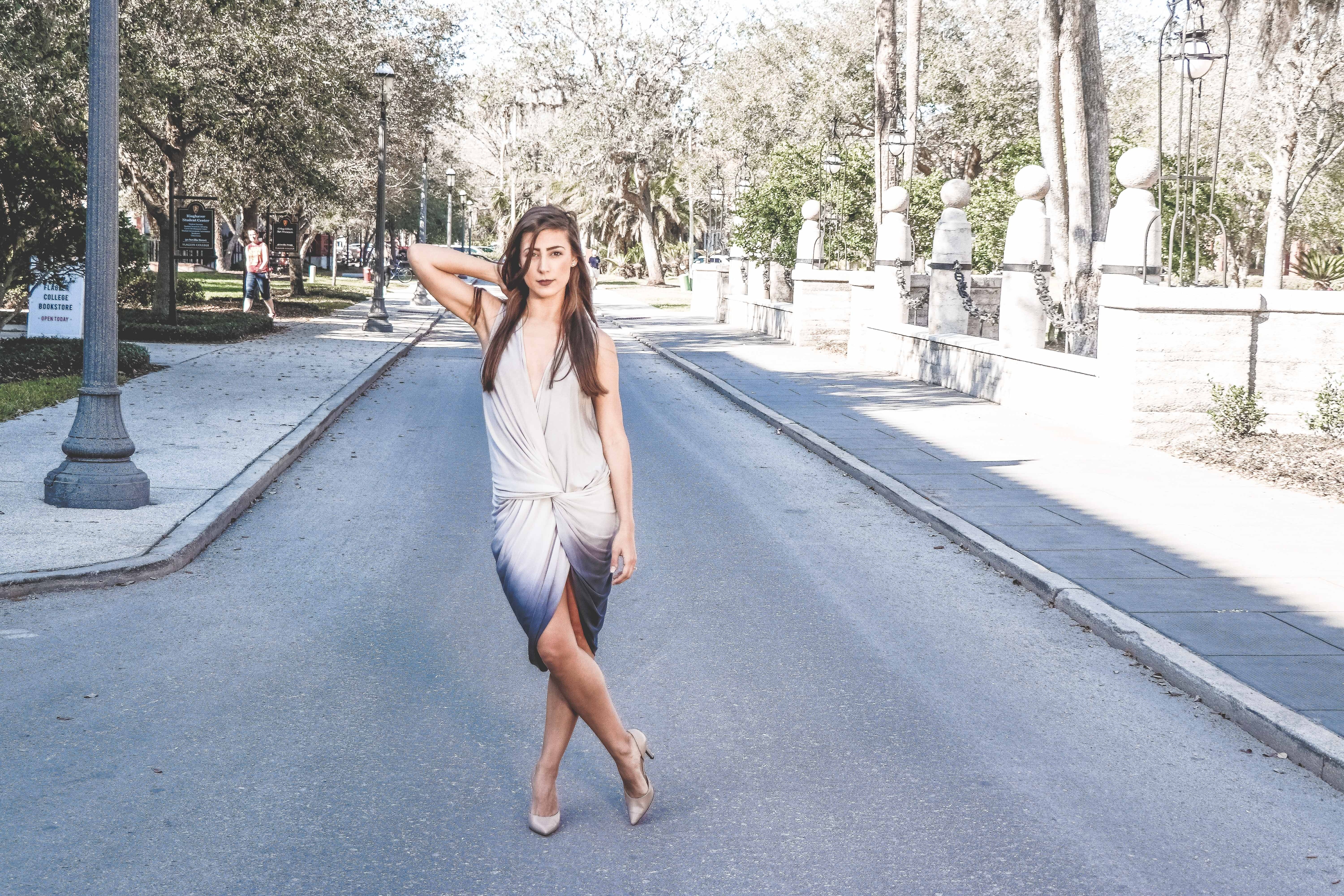 Woman Standing on Street With Cross Leg, Adult, Pavement, Wear, Travel, HQ Photo
