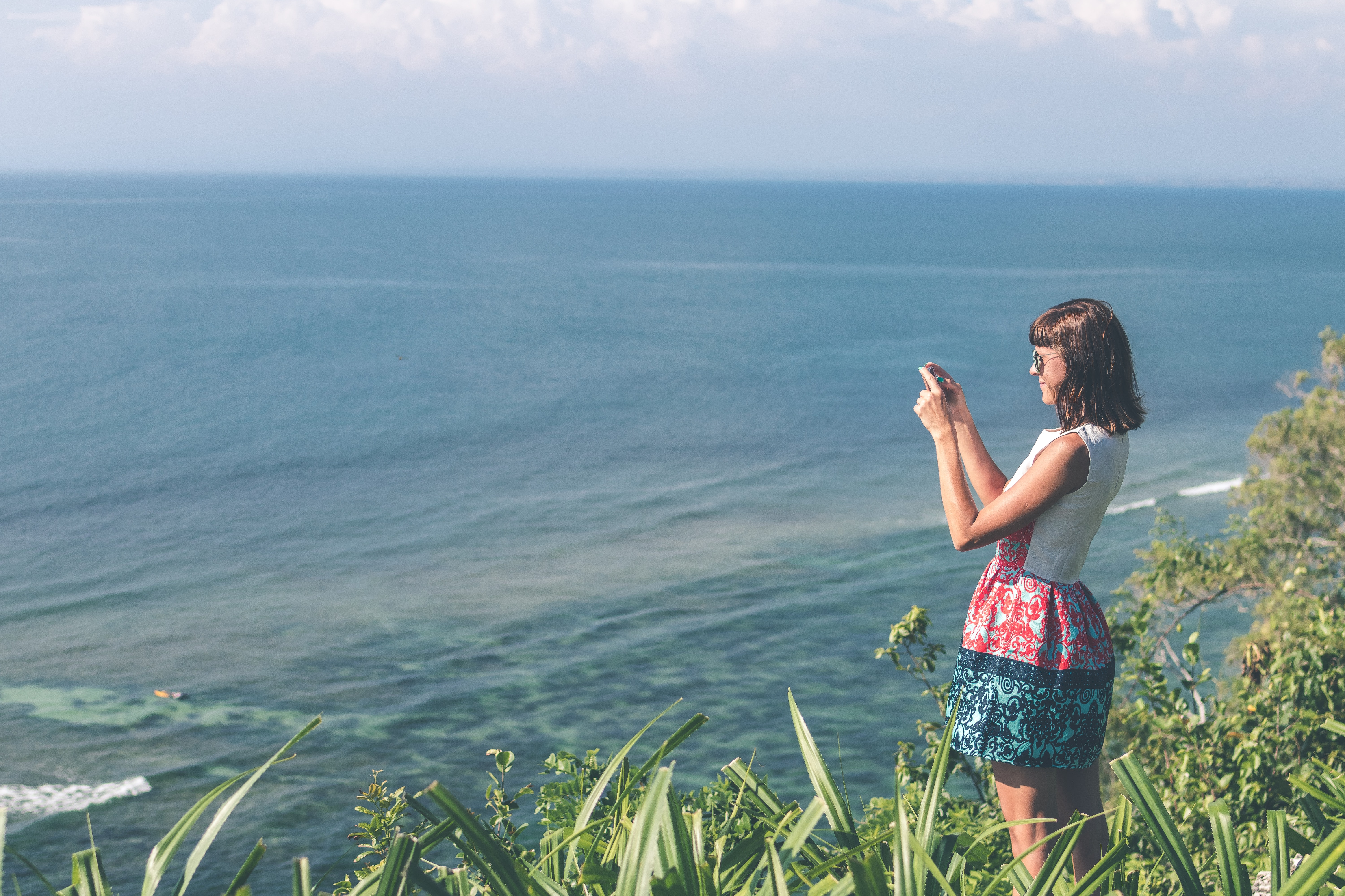 Woman Standing White and Blue Floral Dress Holding Smartphone in Grass Area, Camera, Sea, Woman, White, HQ Photo
