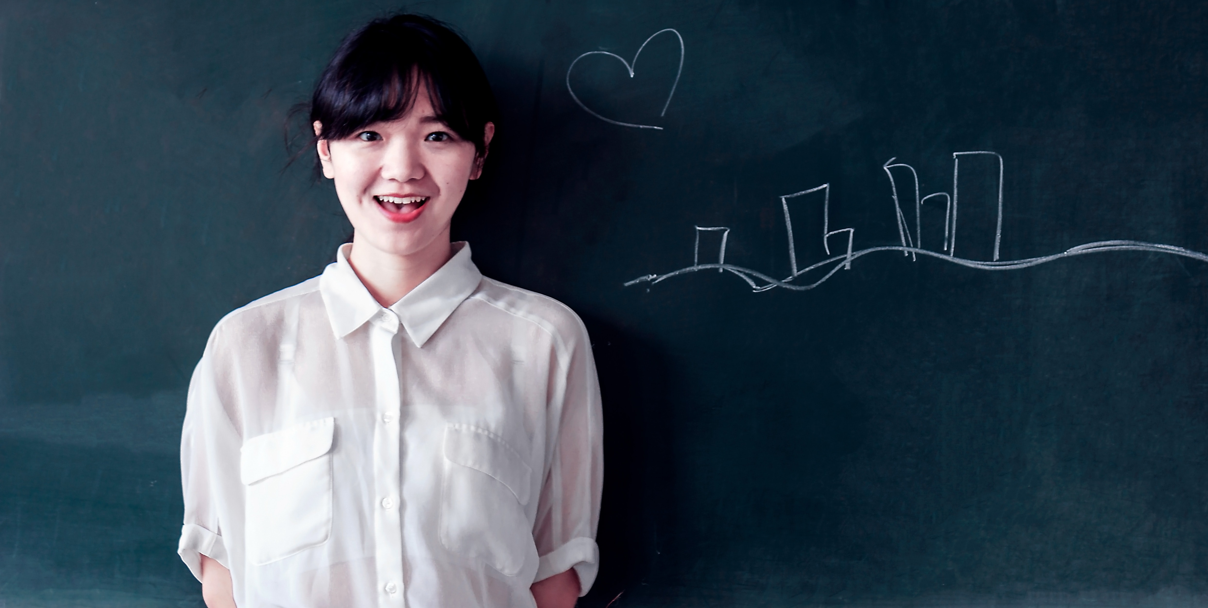 Woman Stands Behind Green Concrete Wall, Learning, Writing, White shirt, Teacher, HQ Photo