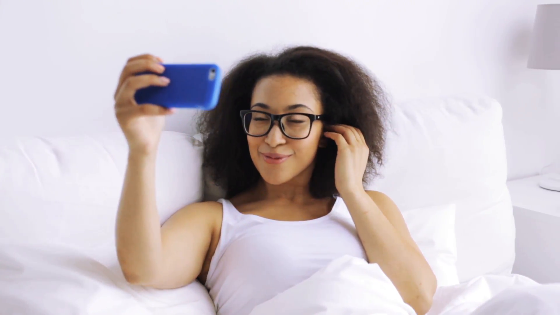 rest, technology and people concept - young african woman smartphone ...