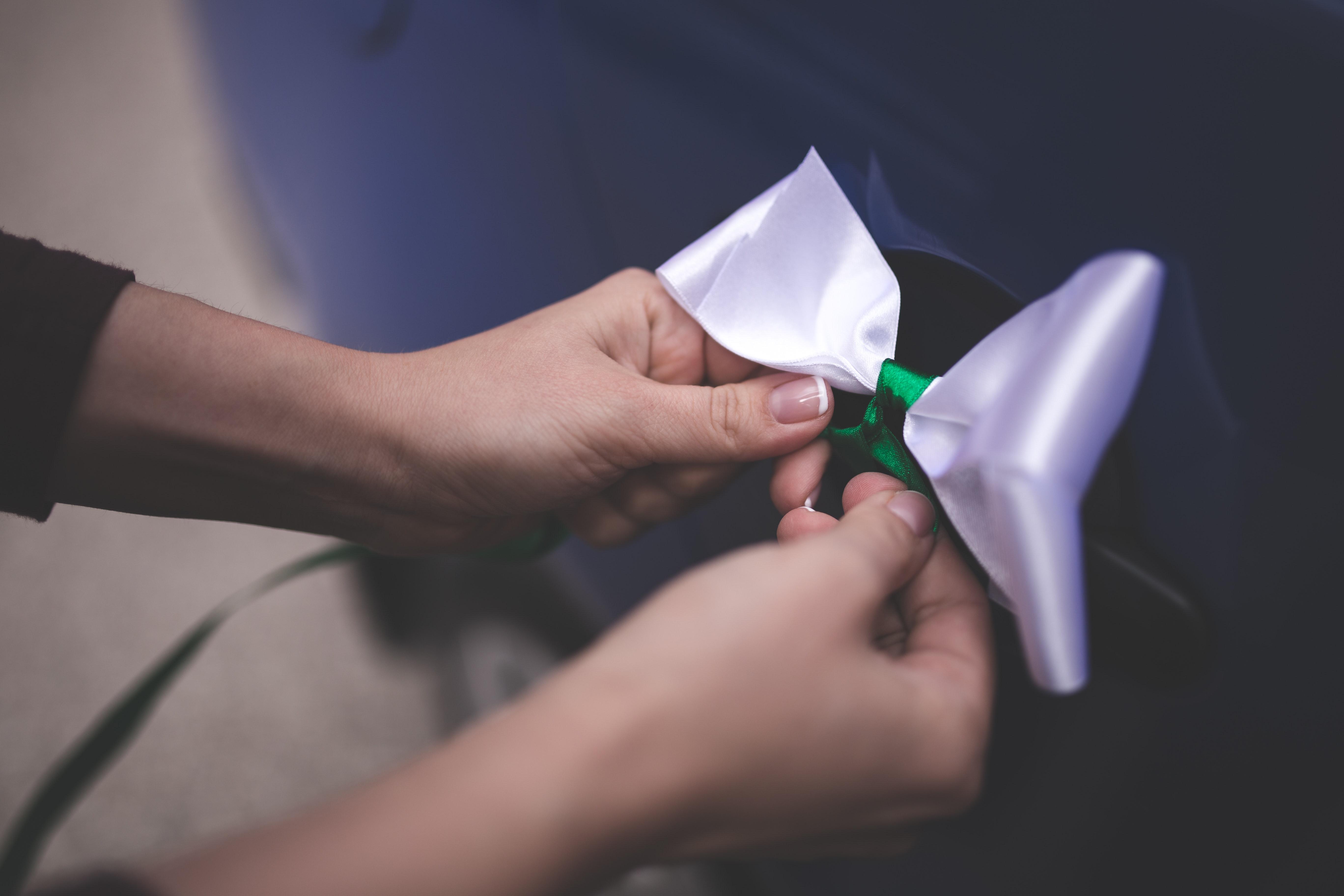 Woman tying a white bow photo